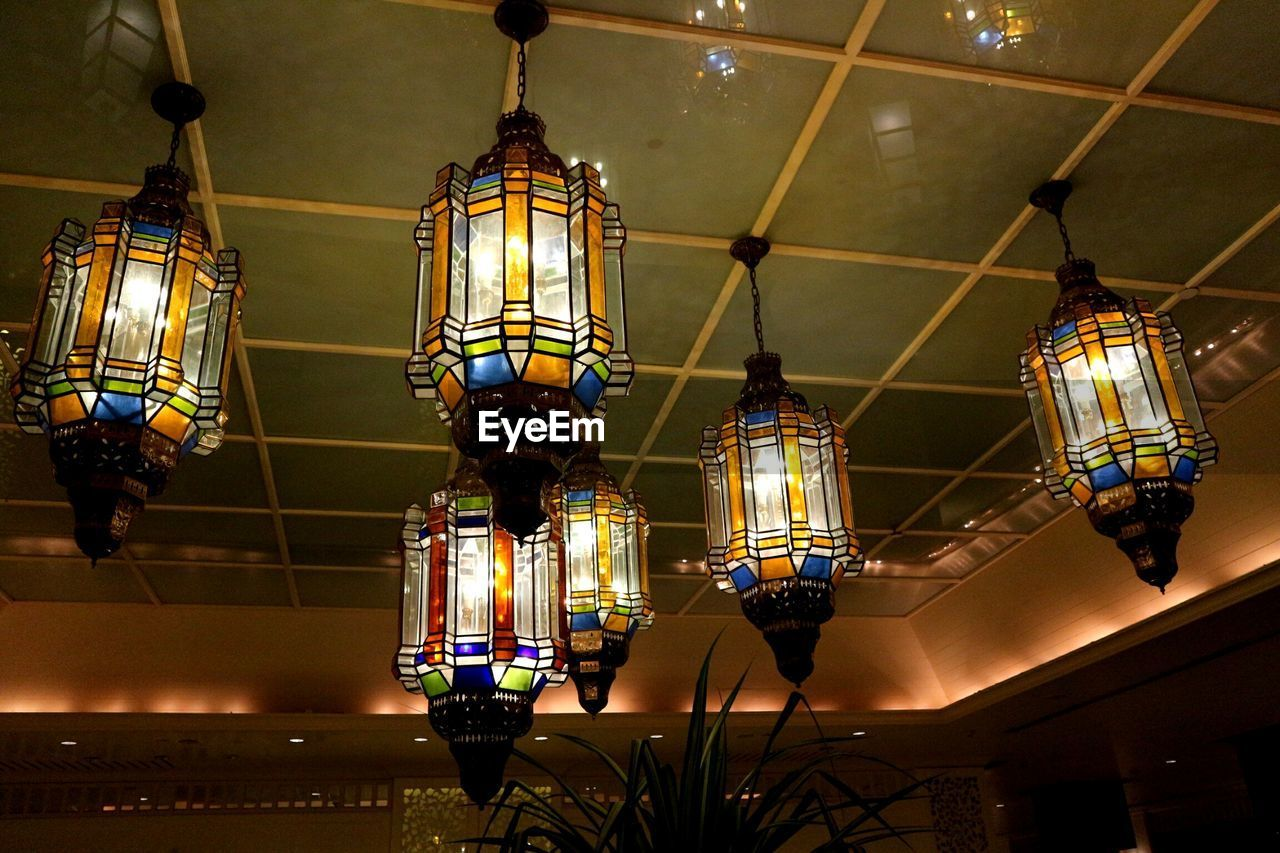 illuminated, hanging, lighting equipment, ceiling, low angle view, indoors, glowing, no people, decoration, light, architecture, electric light, pendant light, built structure, electricity, night, chandelier, pattern, lantern, design, electric lamp, light fixture, ornate