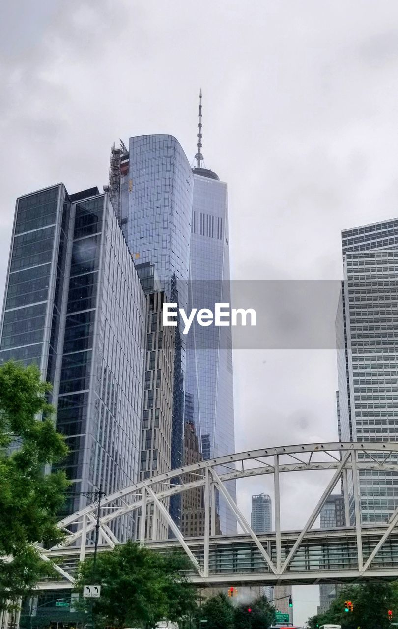 built structure, architecture, building exterior, city, office building exterior, building, sky, office, modern, skyscraper, tall - high, nature, no people, low angle view, cloud - sky, day, tower, transportation, connection, outdoors, financial district