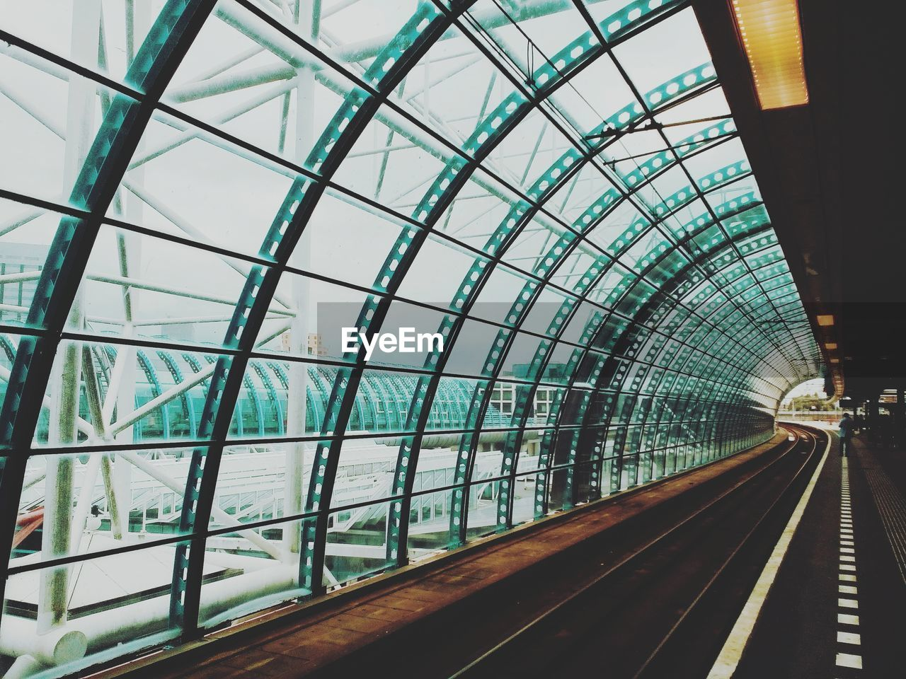architecture, rail transportation, transportation, track, railroad track, built structure, public transportation, indoors, metal, day, glass - material, mode of transportation, travel, transparent, no people, diminishing perspective, railroad station, bridge, the way forward, modern, ceiling