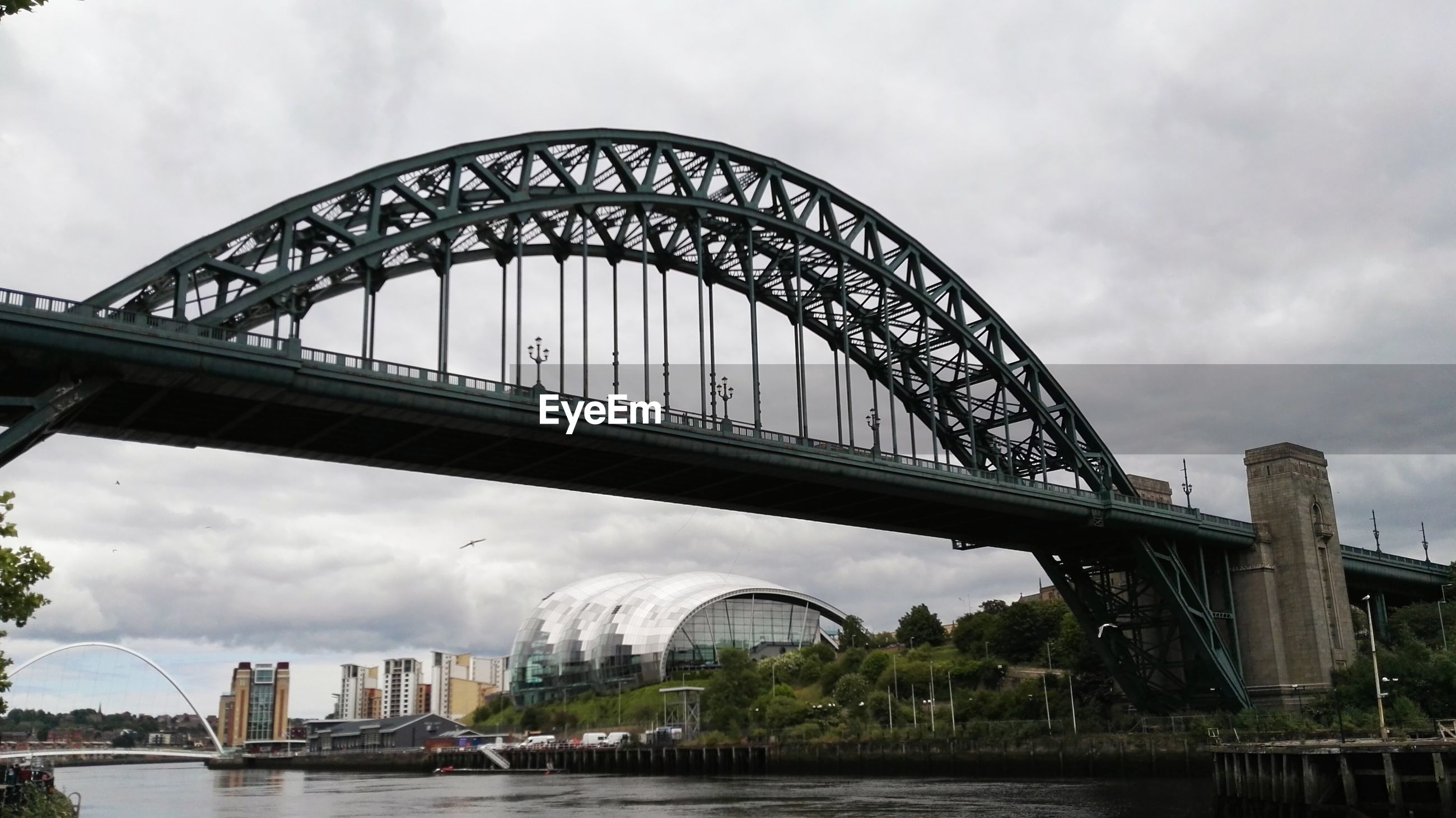 Low angle view of tyne bridge against cloudy sky