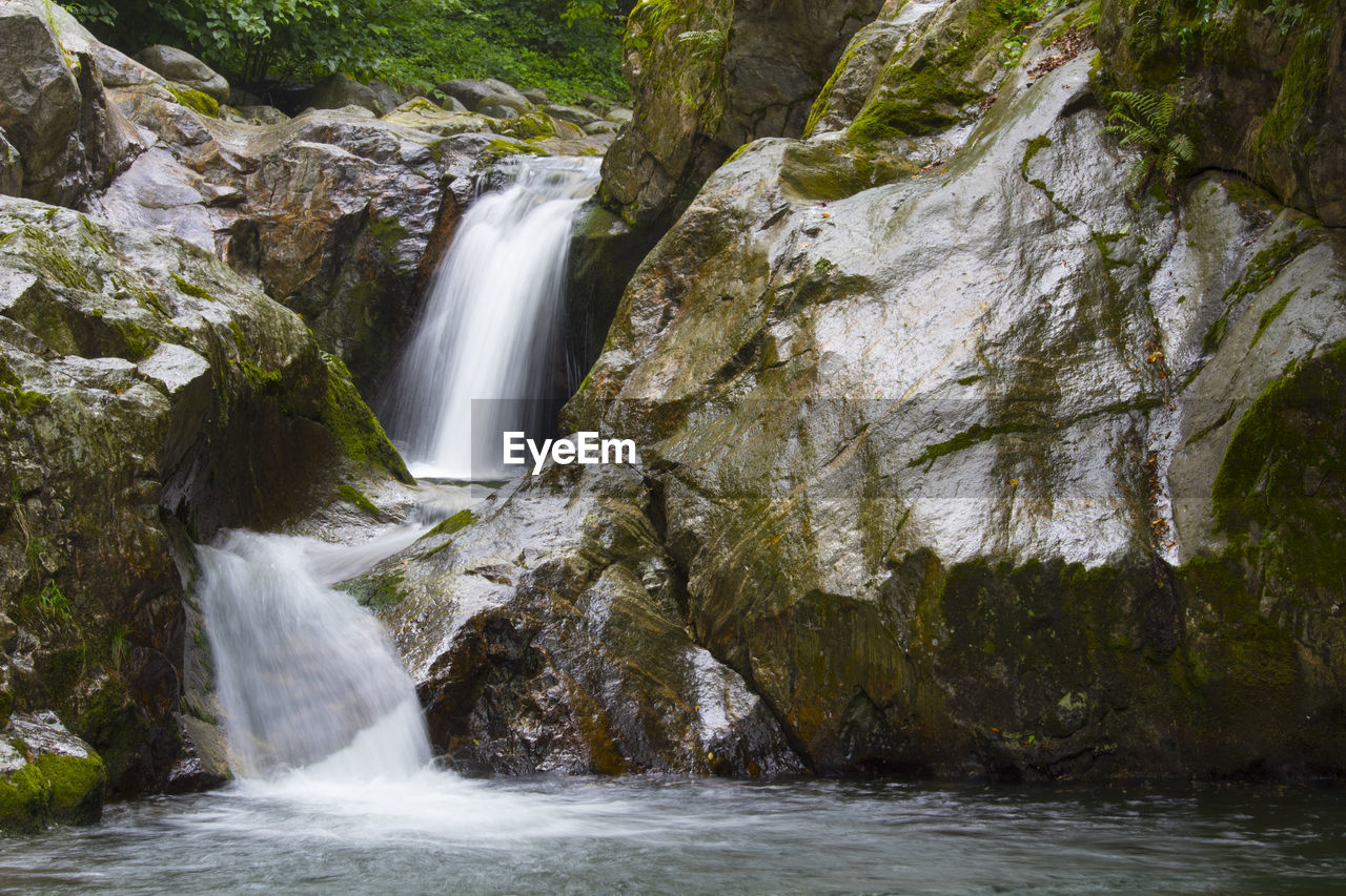 scenics - nature, water, motion, waterfall, flowing water, long exposure, rock, rock - object, beauty in nature, solid, nature, blurred motion, rock formation, sport, environment, forest, no people, outdoors, non-urban scene, flowing, power in nature, stream - flowing water, falling water