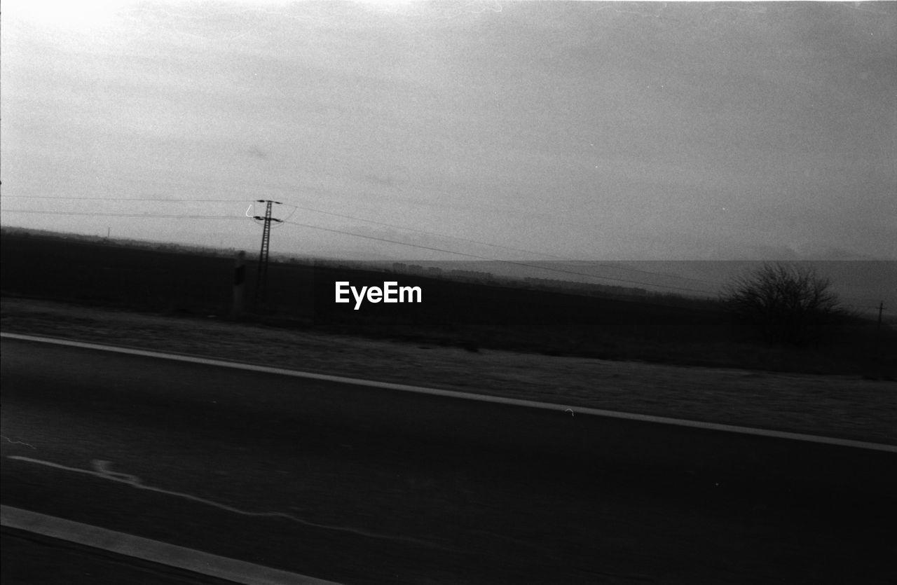 road, transportation, no people, sky, day, landscape, outdoors, nature, electricity pylon, telephone line