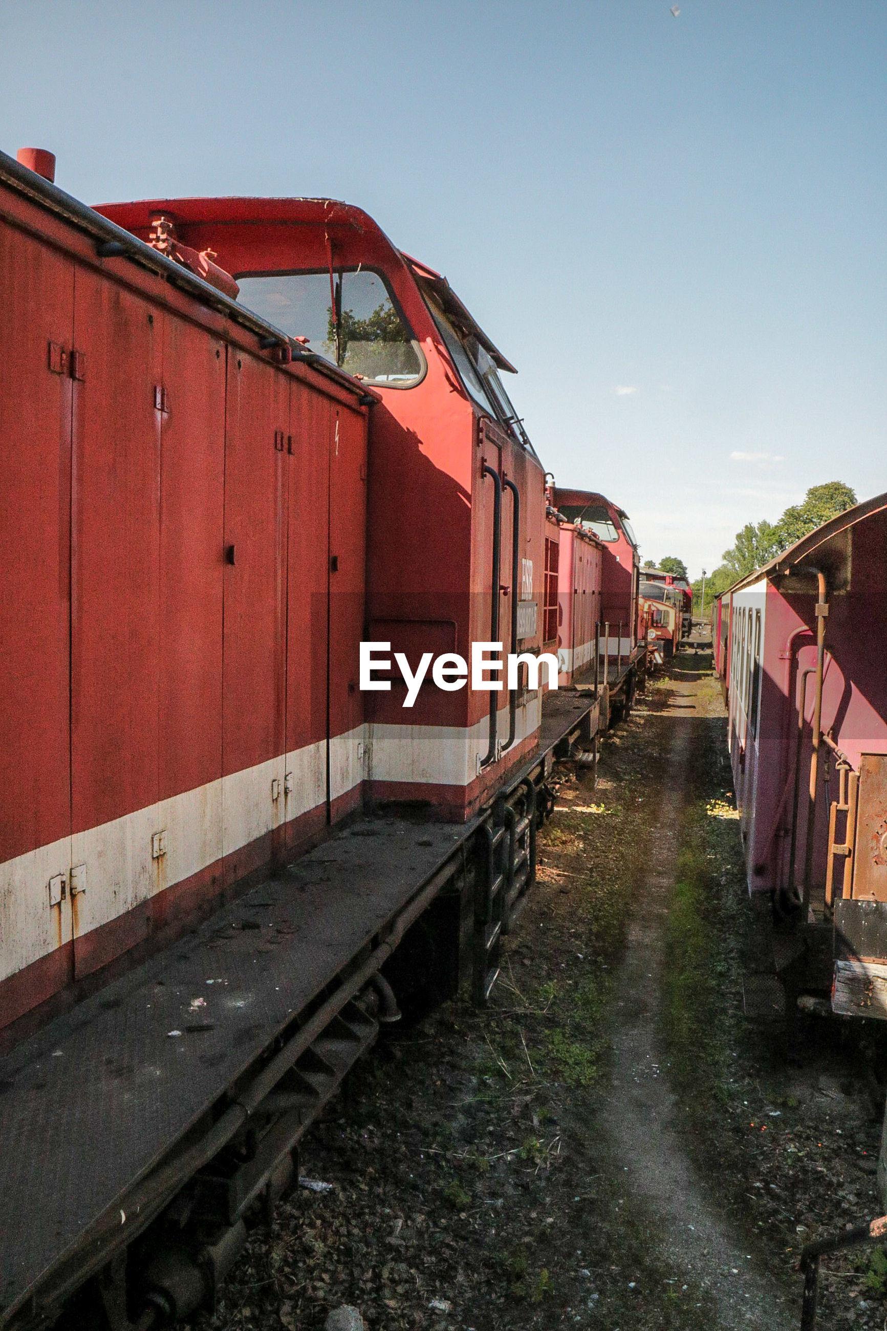 Trains against sky