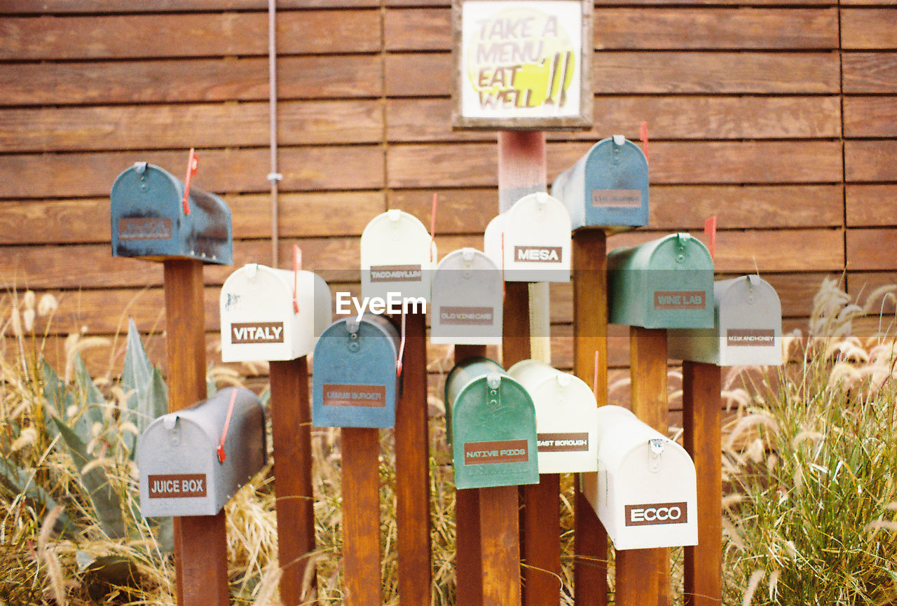 communication, text, western script, mail, day, outdoors, focus on foreground, variation, wood - material, correspondence, no people, public mailbox, close-up