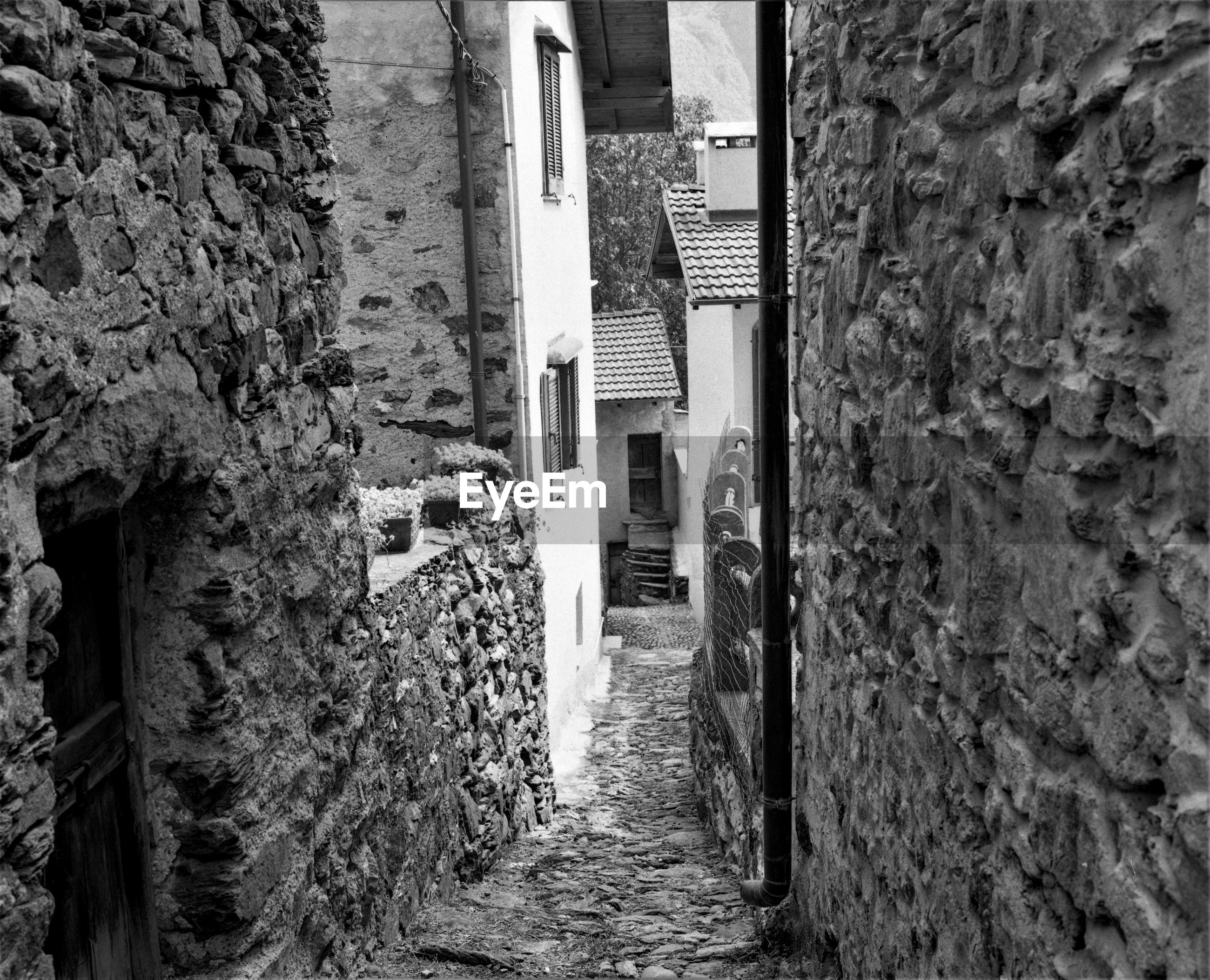 NARROW FOOTPATH AMIDST OLD BUILDINGS