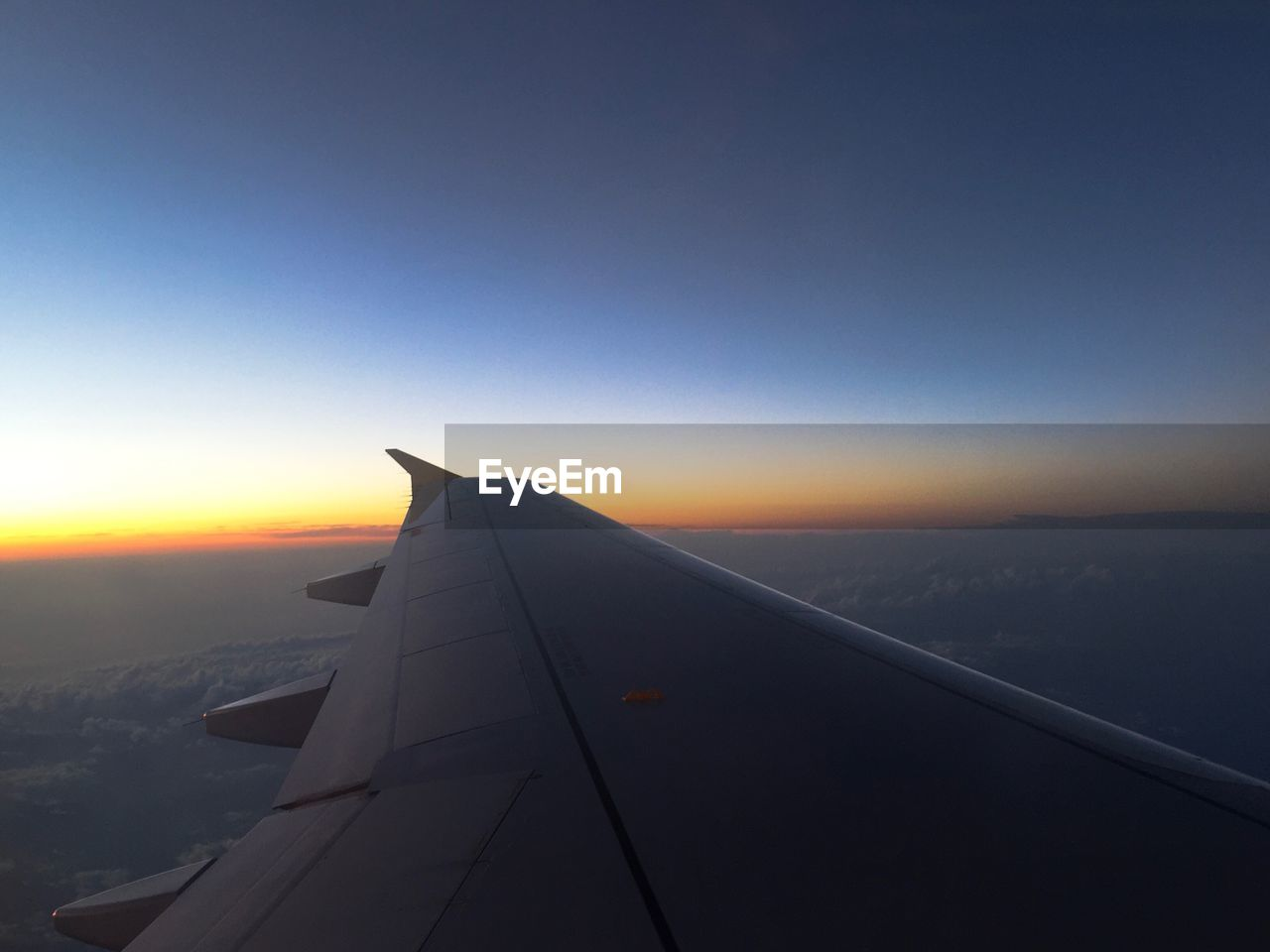 airplane, journey, transportation, travel, airplane wing, sunset, aircraft wing, aerial view, nature, air vehicle, sky, flying, mode of transport, no people, scenics, beauty in nature, blue, outdoors, day