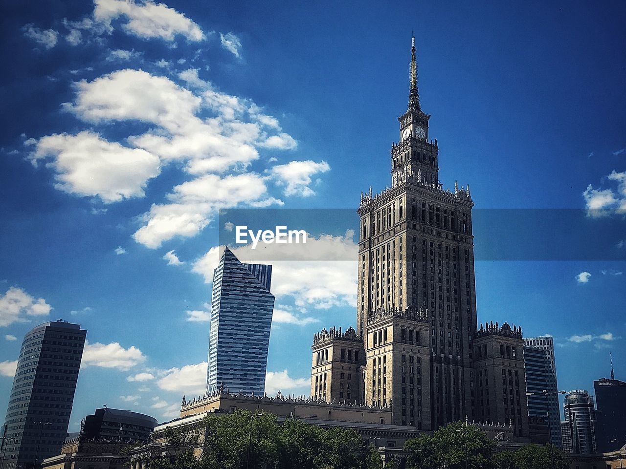 building exterior, built structure, architecture, sky, building, tower, tall - high, low angle view, skyscraper, office building exterior, city, travel destinations, modern, cloud - sky, nature, office, tourism, no people, day, spire, outdoors, financial district