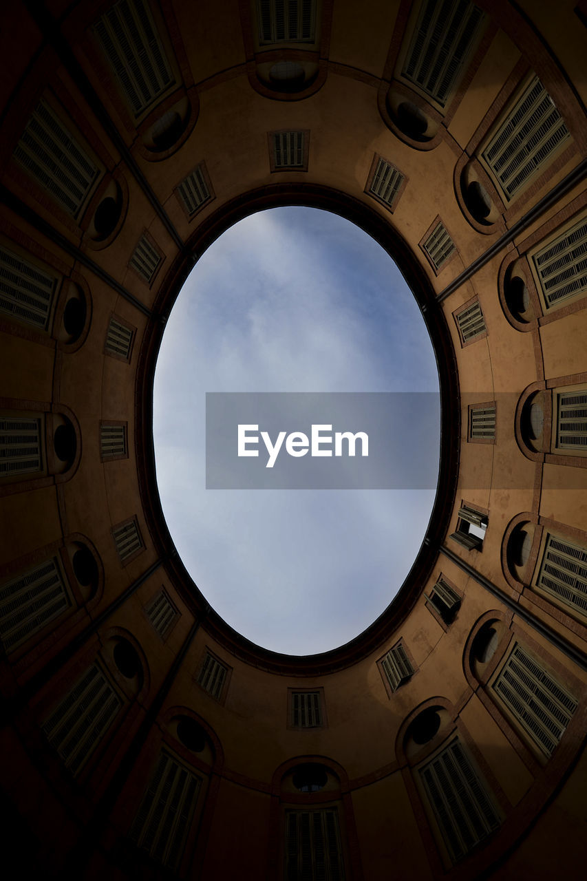 circle, low angle view, pattern, architecture, built structure, day, indoors, no people, sky