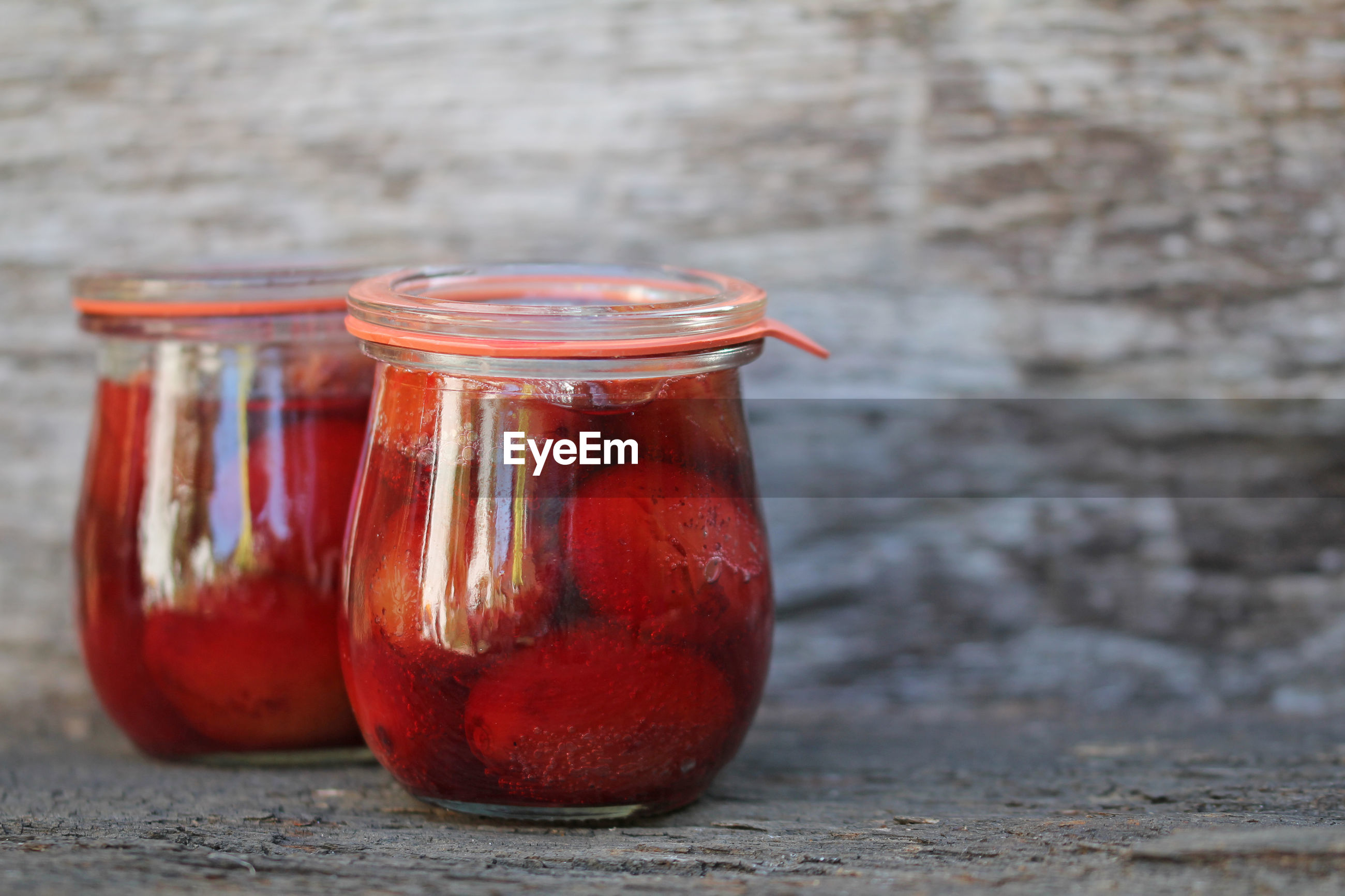 CLOSE-UP OF JUICE IN GLASS JAR ON TABLE