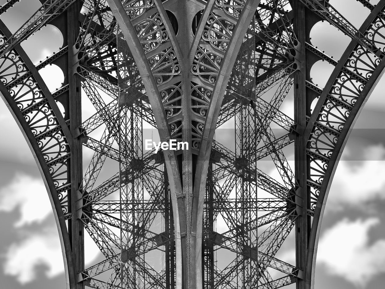 low angle view, architecture, sky, built structure, metal, no people, day, nature, outdoors, arts culture and entertainment, cloud - sky, pattern, grid, tall - high, travel destinations, bridge, connection, city