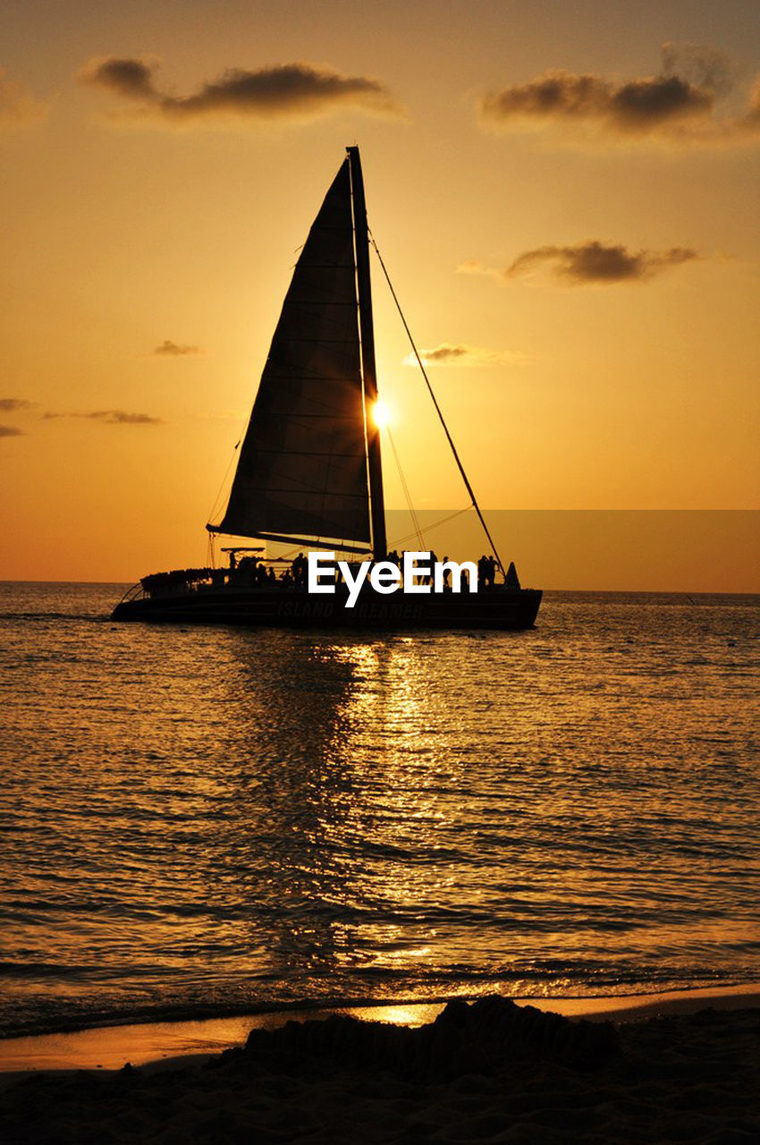 sunset, orange color, sea, water, beauty in nature, nature, sky, silhouette, scenics, sun, reflection, tranquility, cloud - sky, horizon over water, tranquil scene, outdoors, yellow, nautical vessel, no people