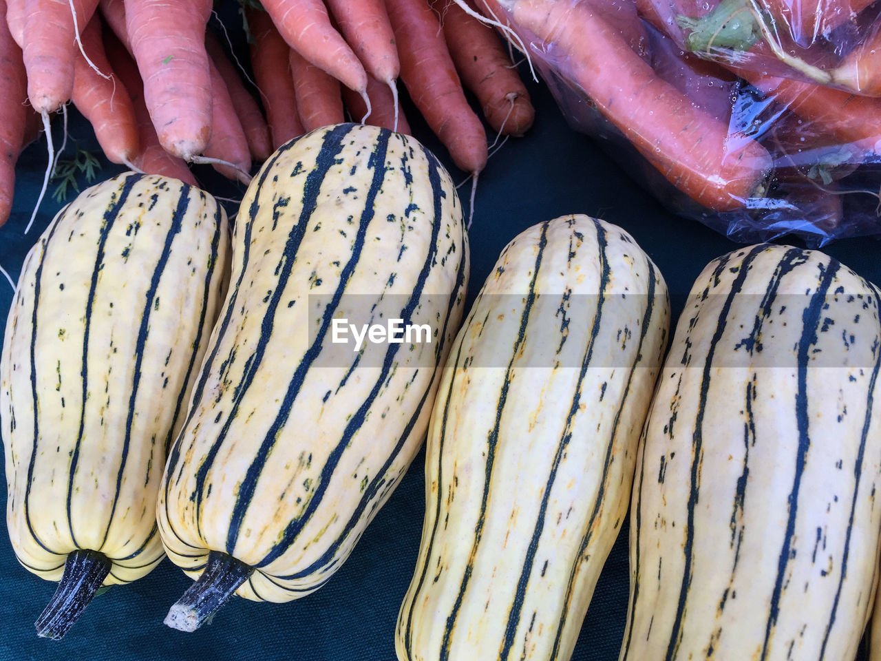 Delicata Squash And Carrots For Sale At Market Stall