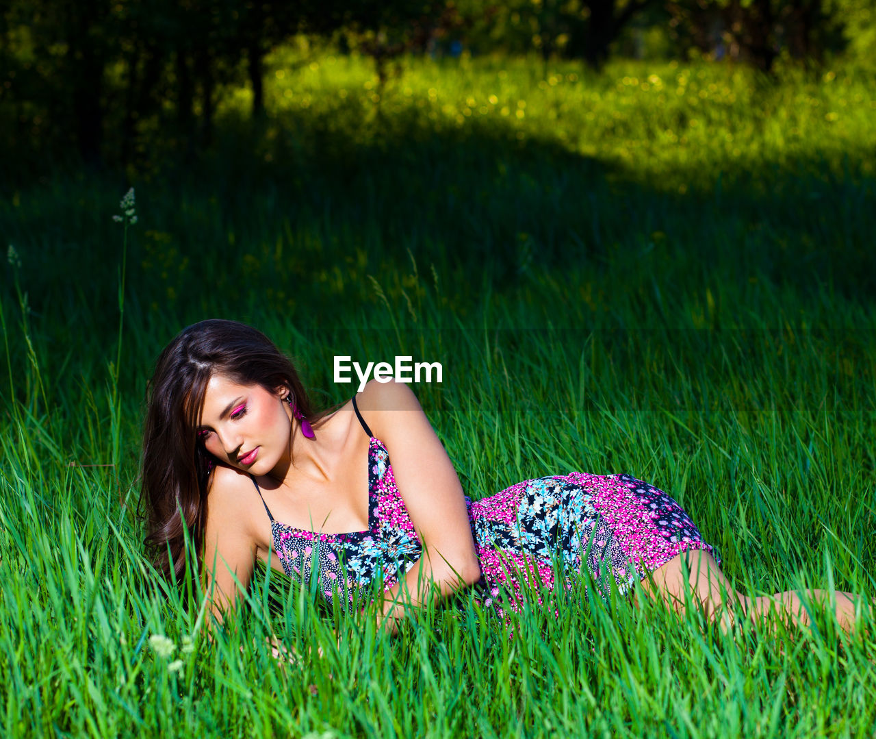 grass, one person, plant, field, real people, land, women, green color, lying down, young adult, leisure activity, young women, nature, lifestyles, relaxation, day, growth, lying on front, beautiful woman, outdoors, hairstyle