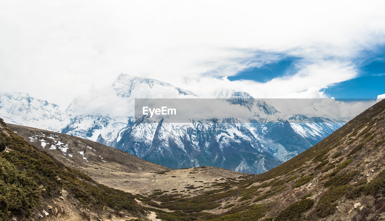 mountain, cloud - sky, sky, scenics - nature, beauty in nature, tranquil scene, landscape, environment, tranquility, mountain range, non-urban scene, cold temperature, winter, nature, no people, snow, idyllic, day, snowcapped mountain, outdoors, mountain peak