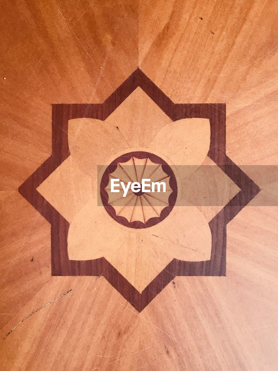 CLOSE-UP OF HARDWOOD FLOOR AGAINST WOODEN WALL