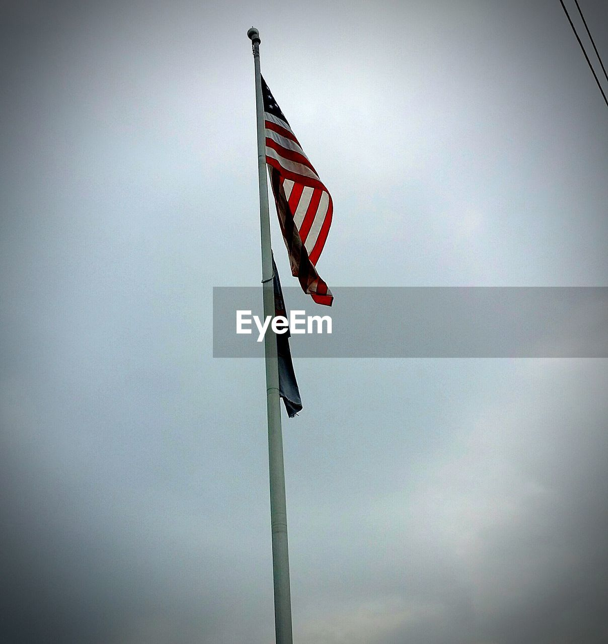 flag, patriotism, low angle view, flag pole, pride, striped, red, no people, stars and stripes, day, outdoors, sky