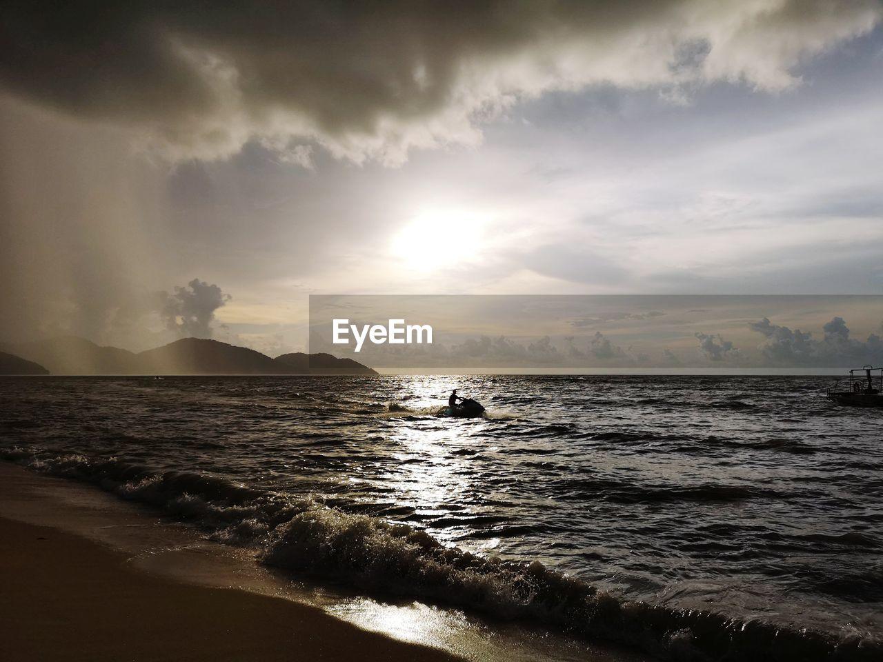 sea, water, sky, cloud - sky, beach, scenics - nature, beauty in nature, land, sunset, horizon, tranquility, nature, horizon over water, tranquil scene, wave, motion, outdoors, no people, idyllic