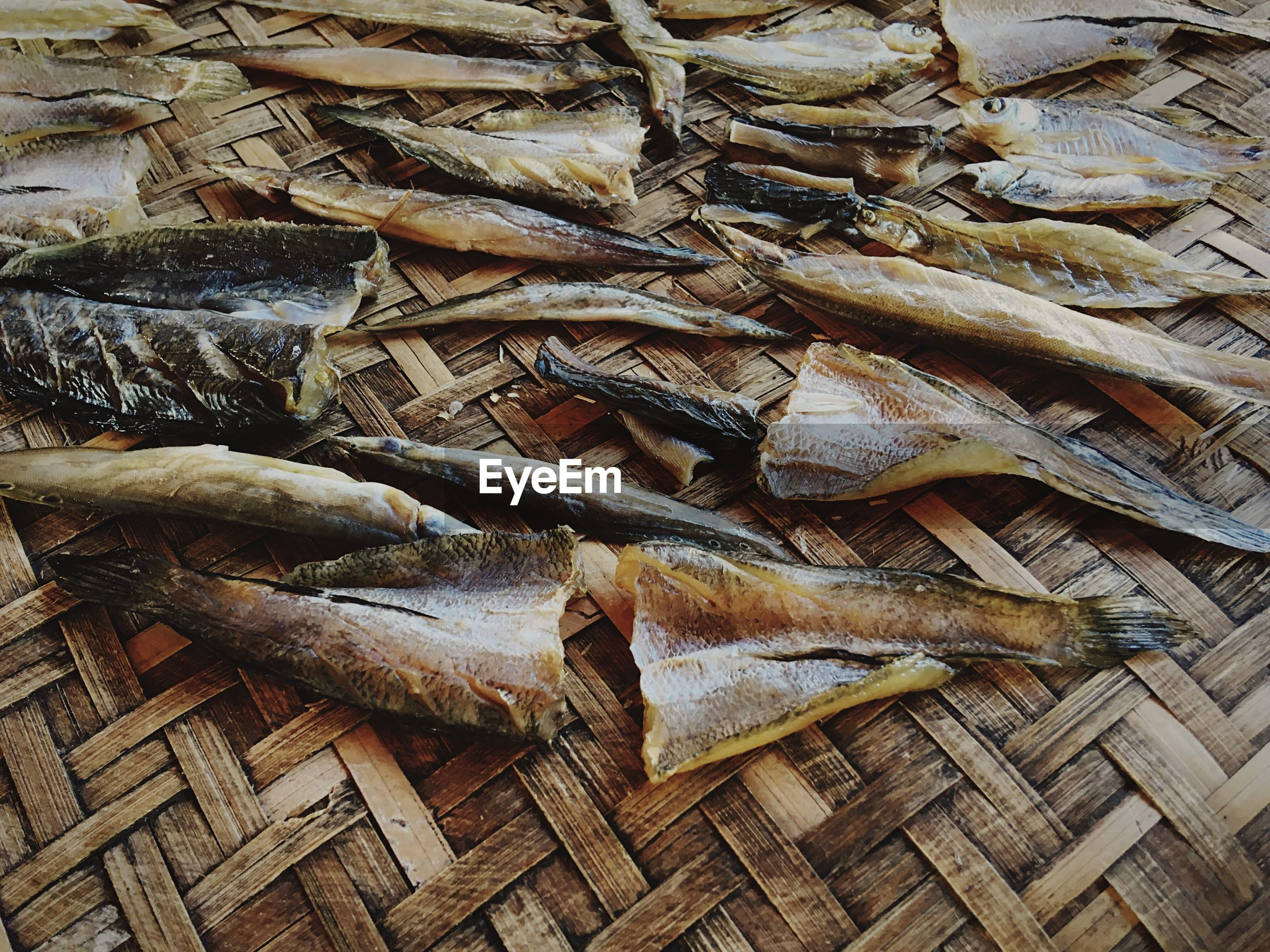 High angle view of dried fish on wicker