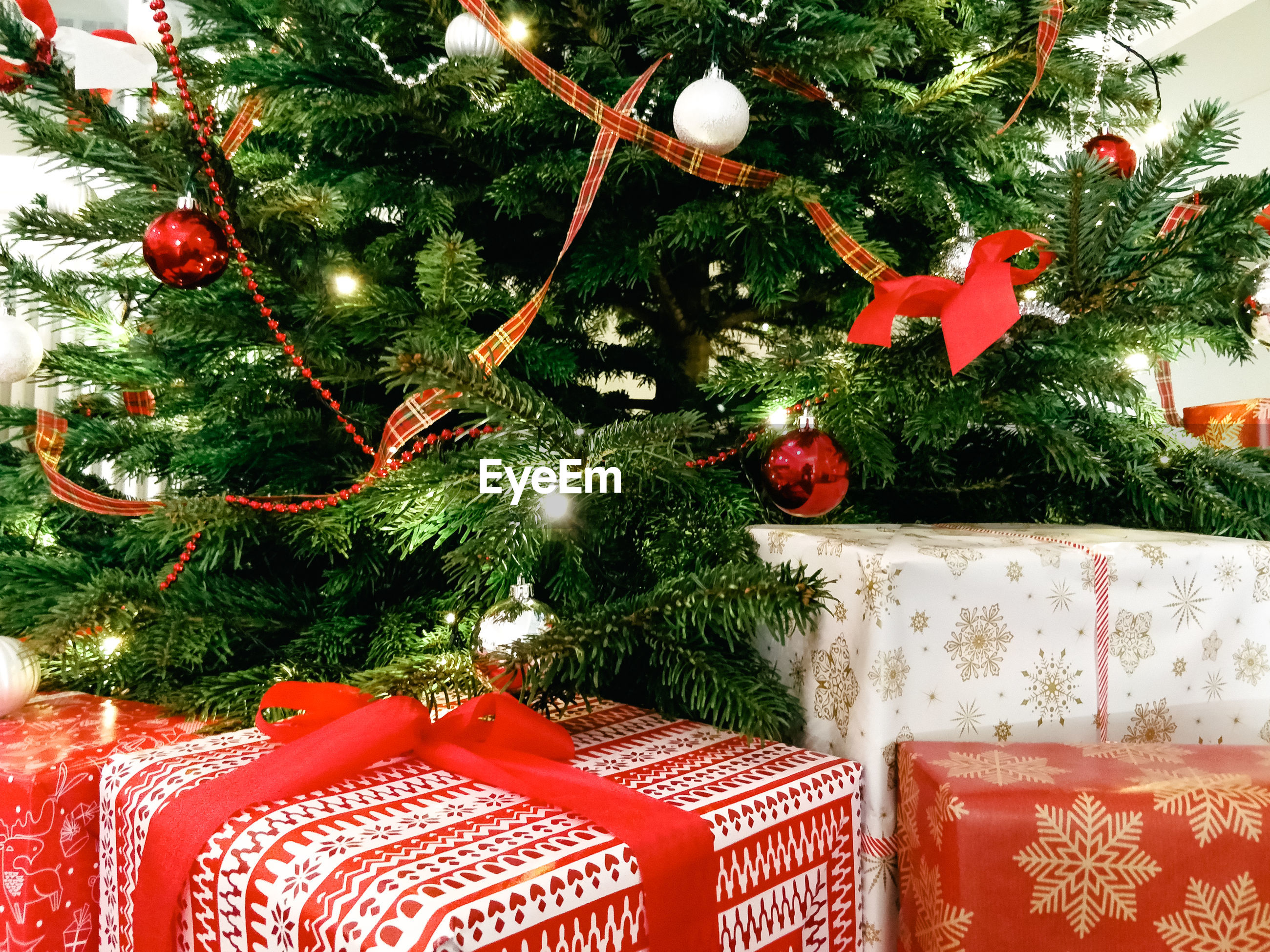 Christmas presents and decoration hanging on christmas tree