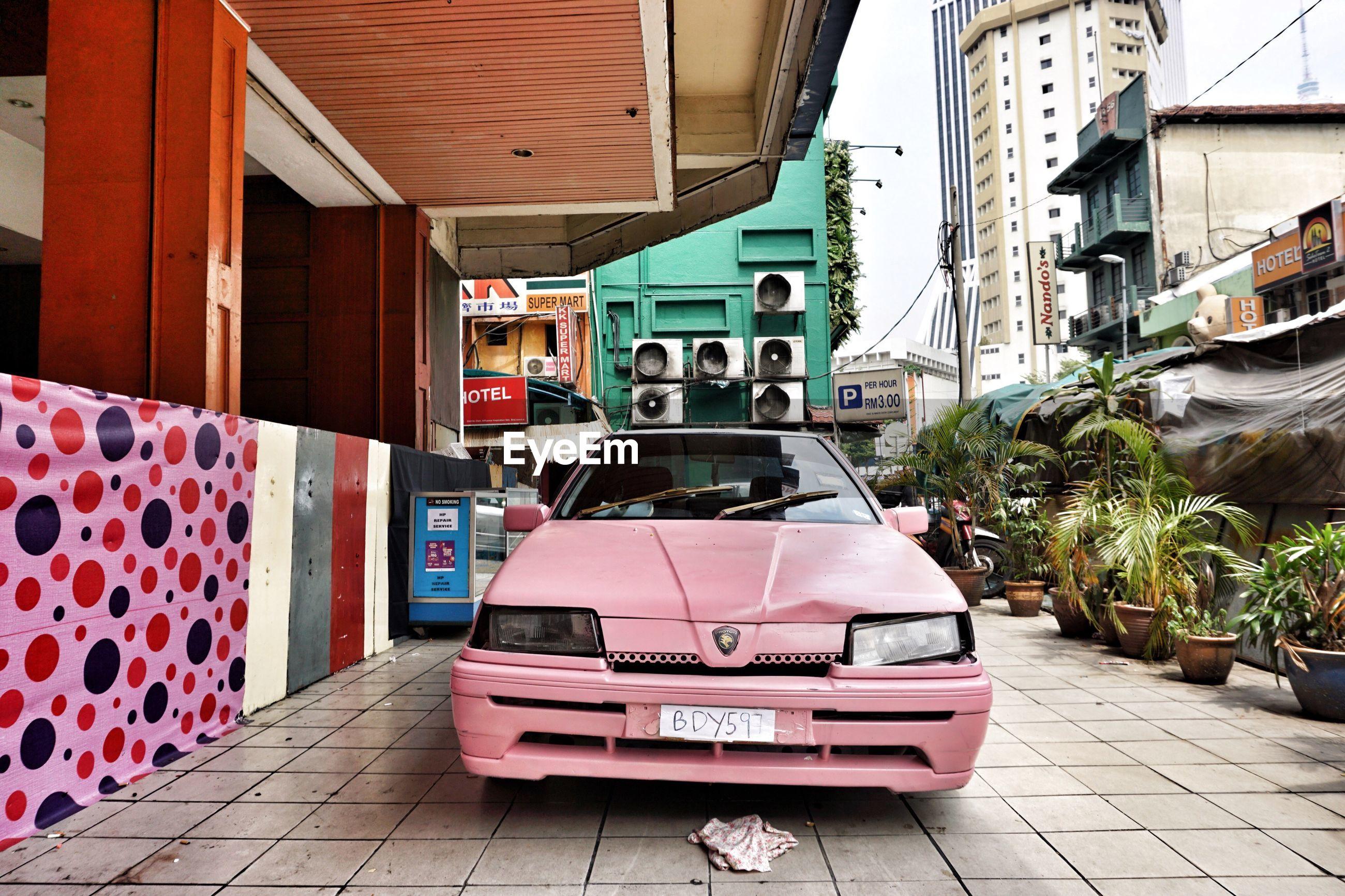 MULTI COLORED CAR ON CITY