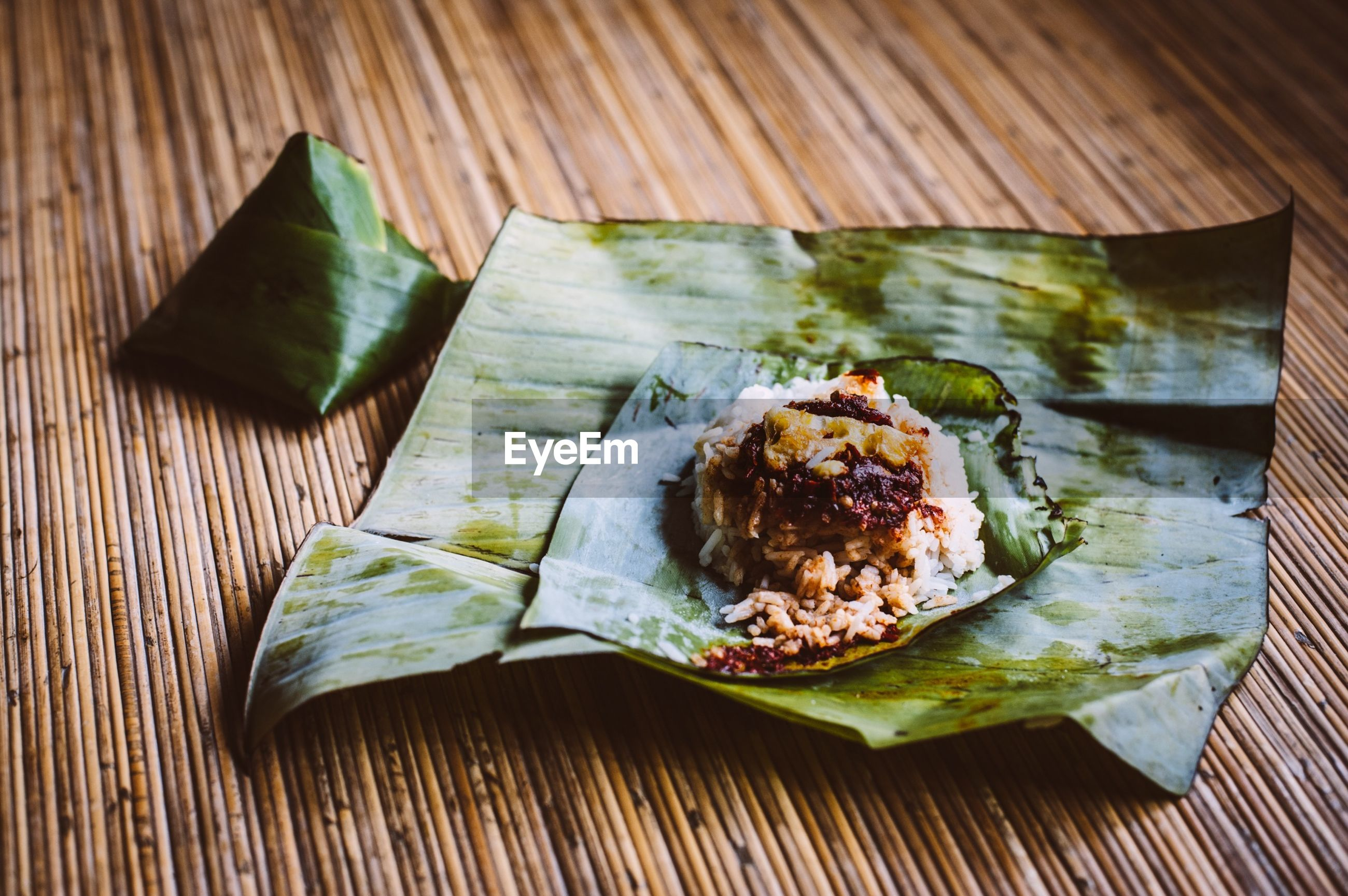 Close-up of rice served on banana leaves
