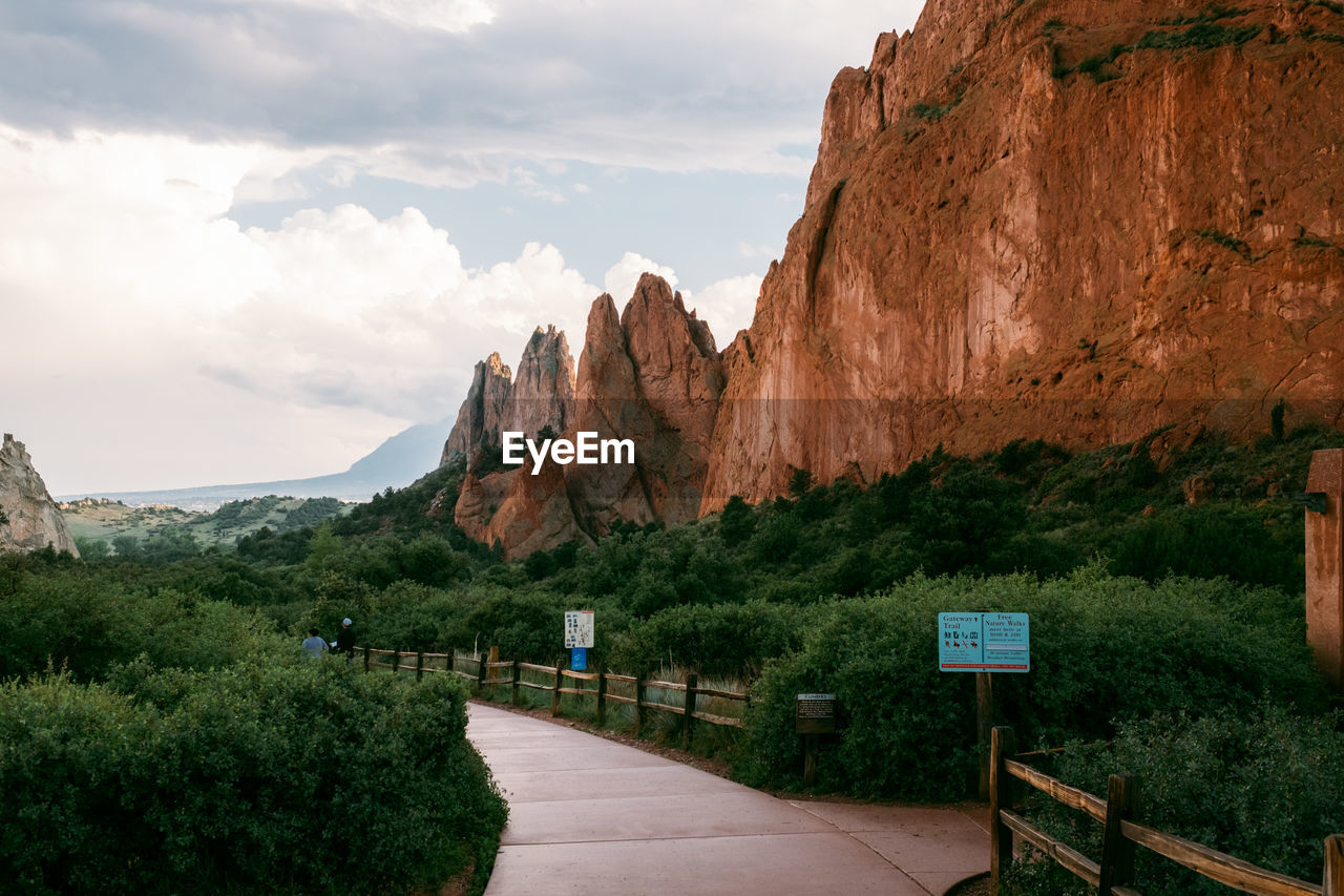 mountain, sky, nature, beauty in nature, direction, plant, cloud - sky, rock, the way forward, rock formation, tranquility, tranquil scene, non-urban scene, scenics - nature, tree, rock - object, mountain range, day, solid, environment, outdoors, no people, formation