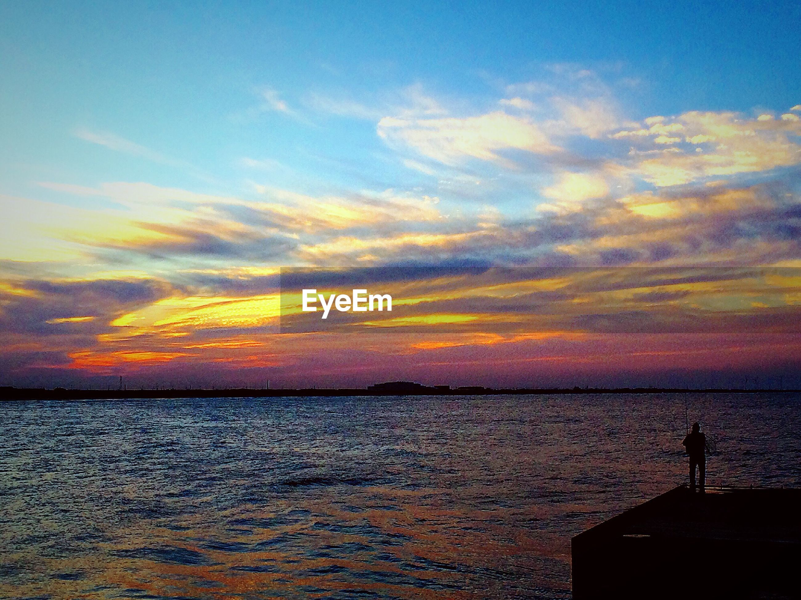 water, sunset, sea, sky, horizon over water, scenics, silhouette, tranquil scene, beauty in nature, tranquility, orange color, waterfront, rippled, cloud - sky, idyllic, nature, cloud, men, leisure activity