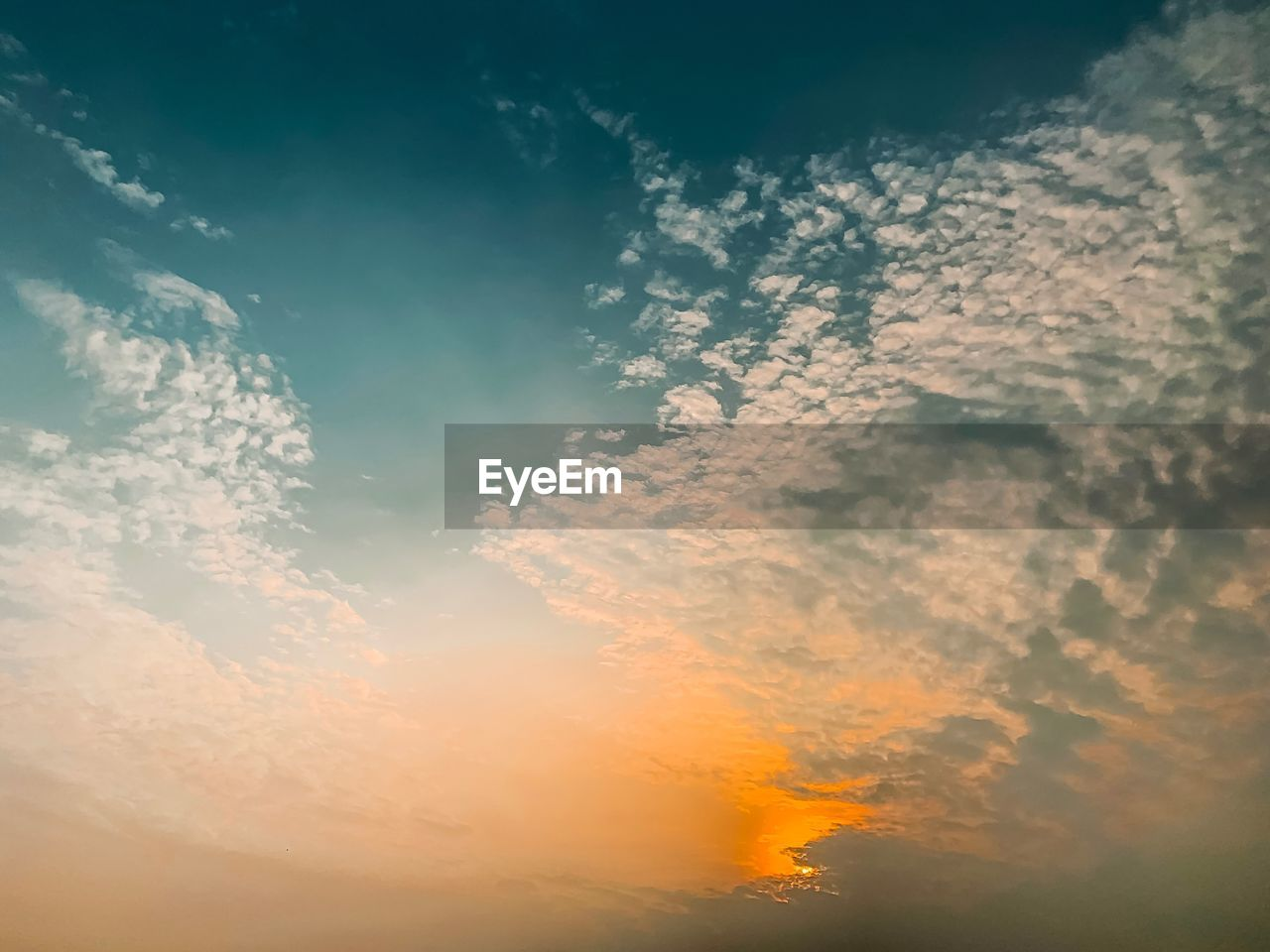 cloud - sky, sky, beauty in nature, sunset, scenics - nature, tranquility, tranquil scene, low angle view, orange color, no people, idyllic, nature, outdoors, full frame, backgrounds, dramatic sky, non-urban scene, sunlight, cloudscape, day, meteorology