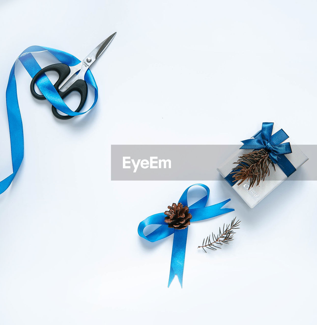 blue, indoors, still life, white background, copy space, studio shot, ribbon, no people, ribbon - sewing item, decoration, bow, high angle view, celebration, tied bow, communication, white color, paper, cut out, representation, text
