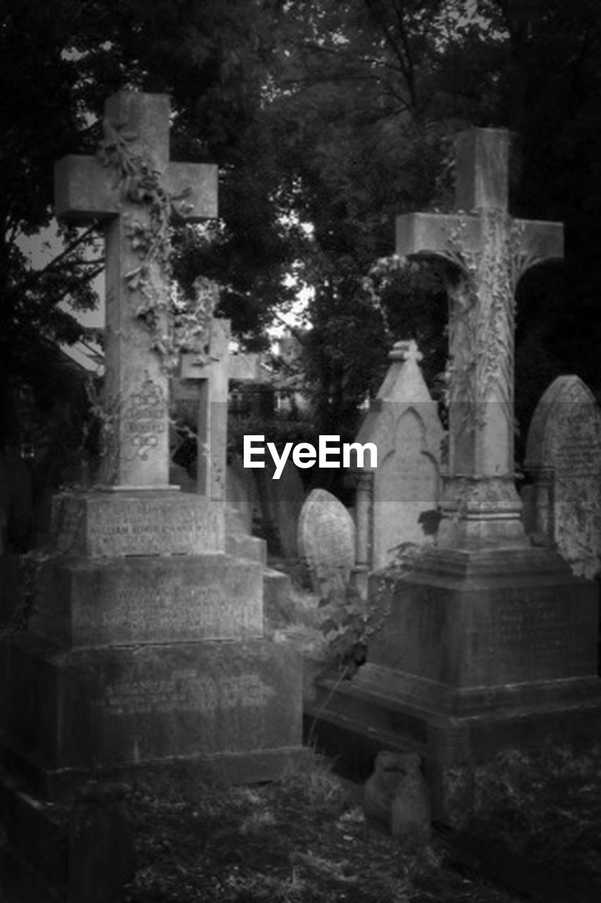 tombstone, cemetery, memorial, cross, gravestone, graveyard, sadness, grave, spirituality, religion, the past, stone material, tree, no people, grief, outdoors, day