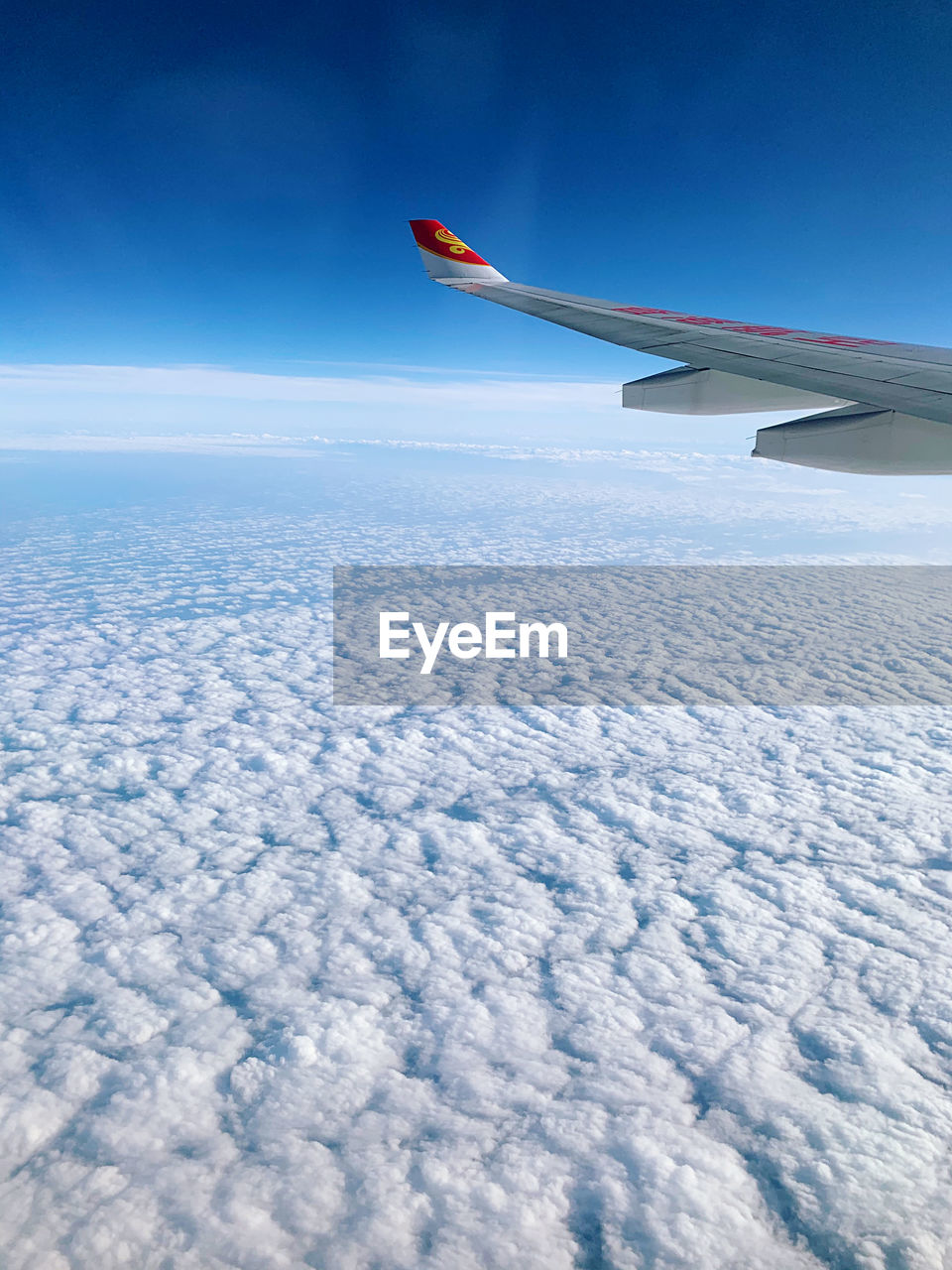 sky, airplane, aircraft wing, air vehicle, flying, mode of transportation, transportation, cloud - sky, nature, no people, beauty in nature, scenics - nature, travel, day, mid-air, blue, aerial view, journey, cloudscape, outdoors