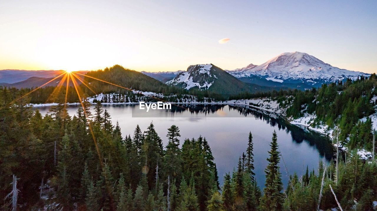 mountain, scenics, beauty in nature, nature, tranquil scene, tranquility, mountain range, majestic, idyllic, no people, sunset, lake, outdoors, water, clear sky, sky, tree, snow, landscape, cold temperature, day