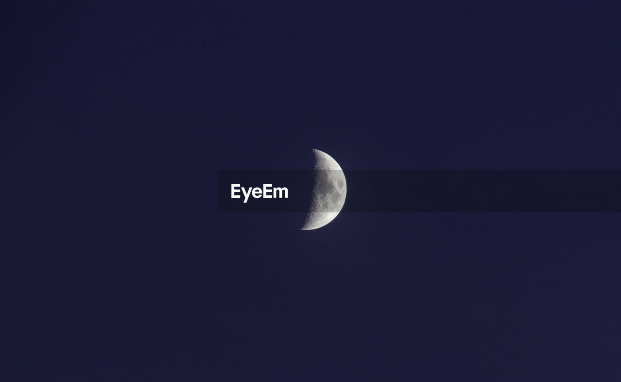 sky, moon, night, space, astronomy, copy space, beauty in nature, half moon, tranquility, low angle view, scenics - nature, planetary moon, clear sky, nature, no people, tranquil scene, moon surface, crescent, idyllic, outdoors, space and astronomy, eclipse