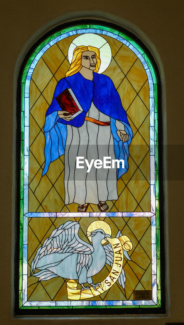 representation, human representation, art and craft, window, creativity, no people, female likeness, architecture, male likeness, stained glass, building, glass - material, built structure, religion, spirituality, place of worship, belief, glass, angel, mural