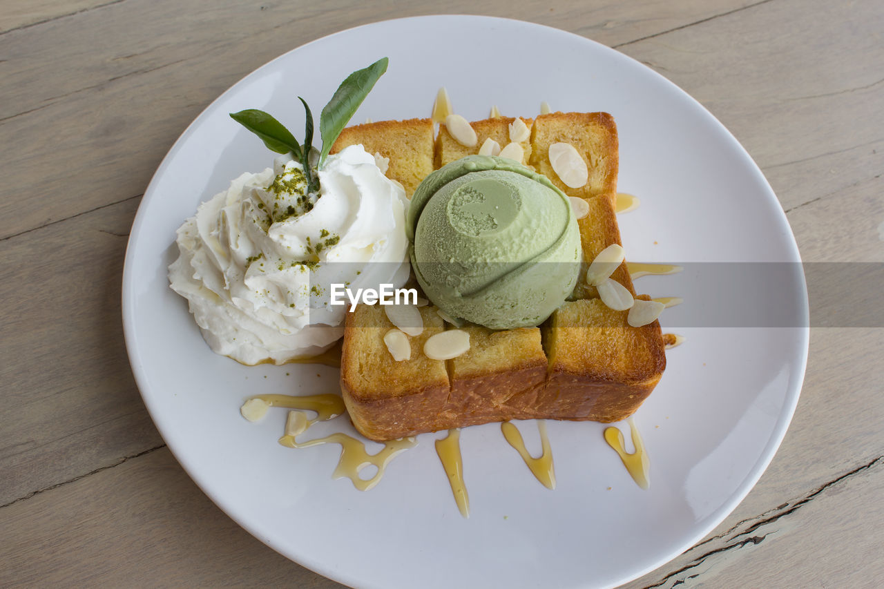 food, food and drink, ready-to-eat, freshness, plate, serving size, table, ice cream, dessert, sweet food, dairy product, sweet, high angle view, frozen, indulgence, still life, frozen food, indoors, no people, directly above, temptation