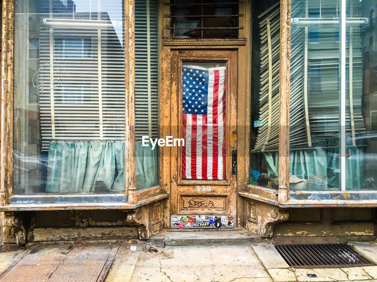 American flag hanging in door