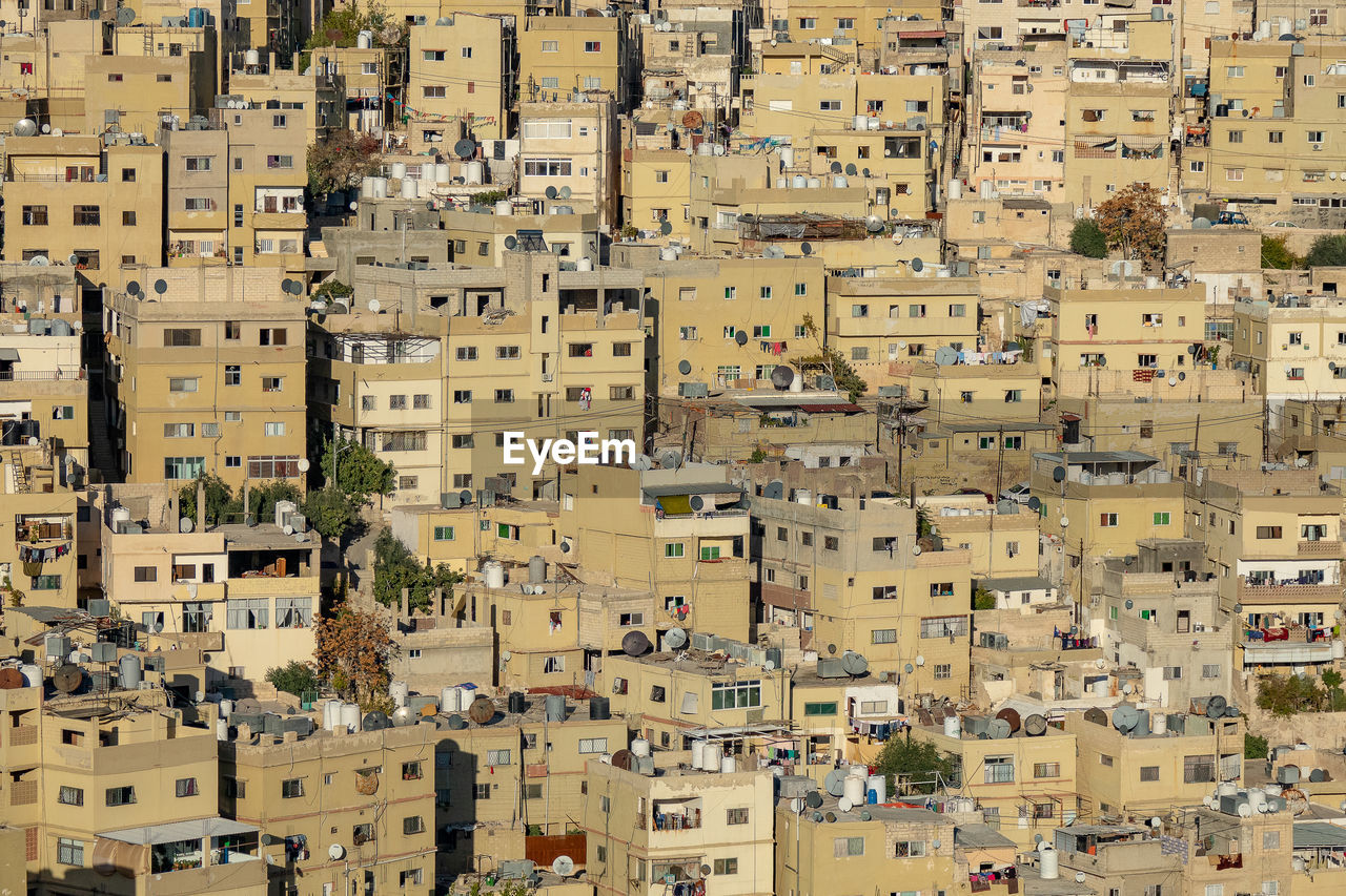 High angle view of residential buildings in city in jordan