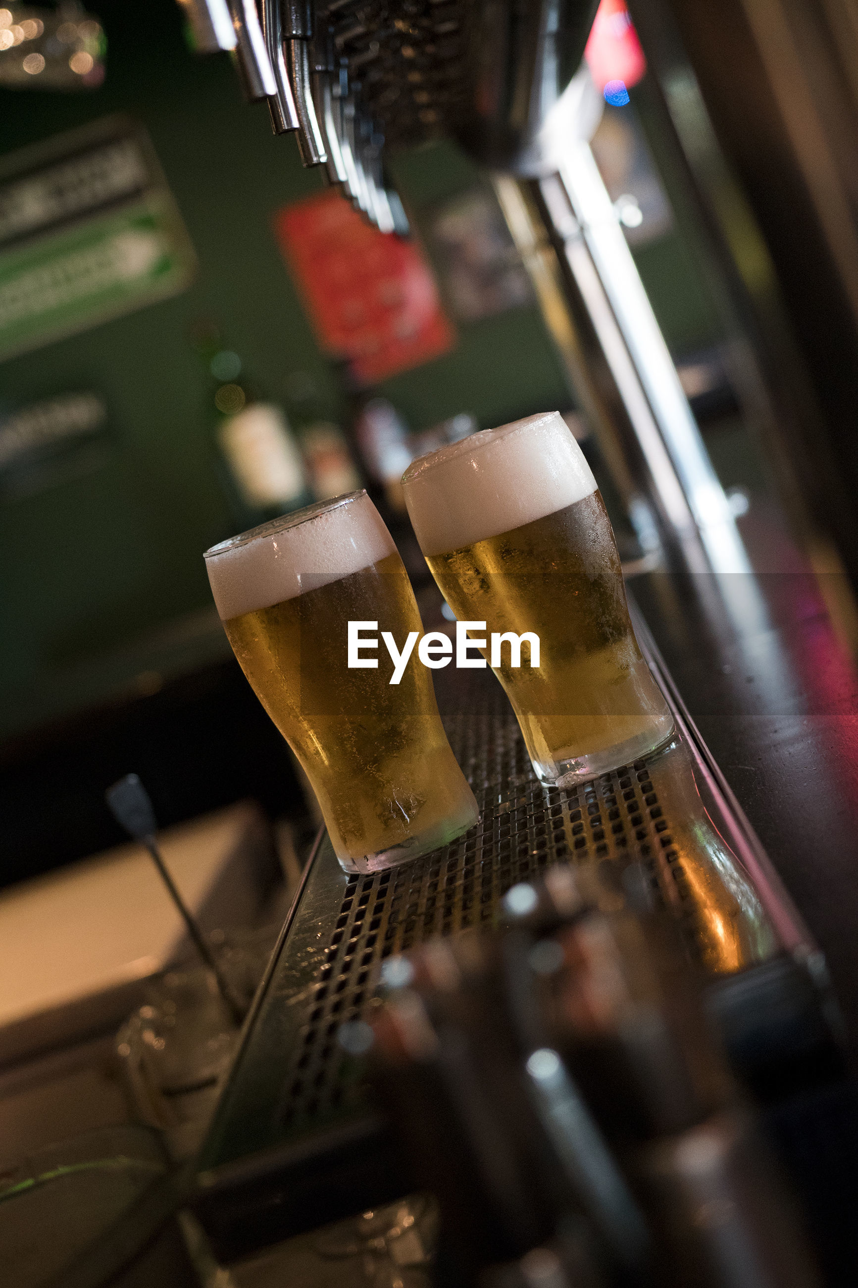 Beer in glasses on bar counter