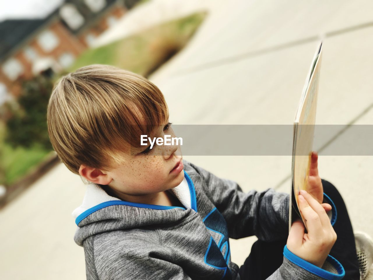 Close-Up Of Boy Holding Book