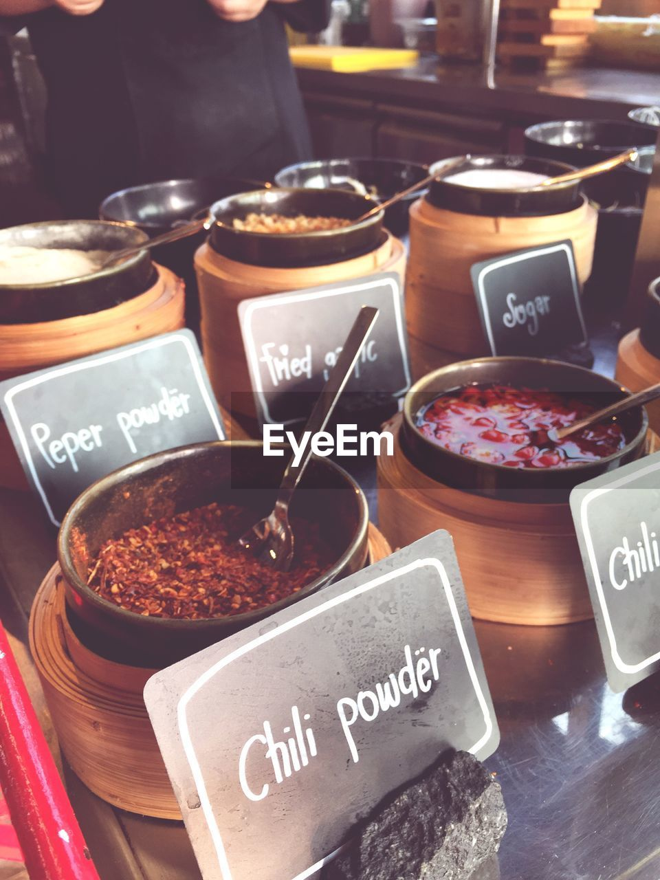 High Angle View Of Spices In Containers For Sale At Market