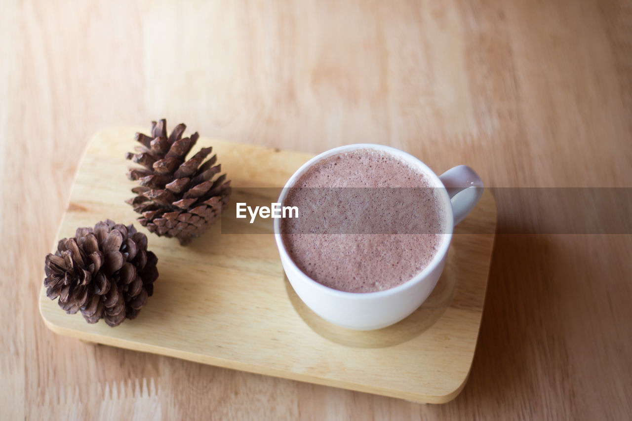 food and drink, still life, food, cup, table, drink, coffee - drink, freshness, wood - material, coffee, indoors, mug, coffee cup, refreshment, no people, brown, close-up, high angle view, focus on foreground, spoon, temptation