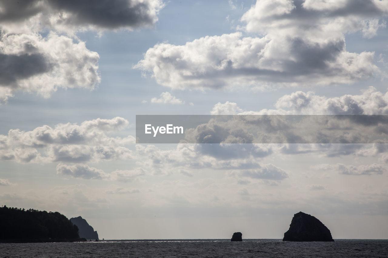 Idyllic Shot Of Cloudy Sky Over Sea