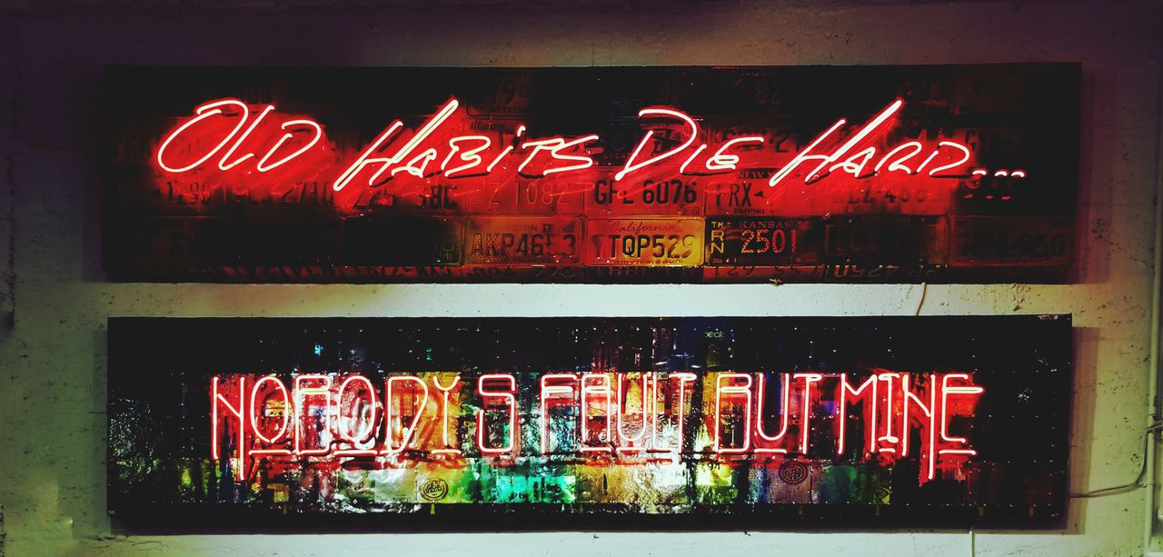 text, communication, western script, illuminated, no people, neon, red, business, store, glass - material, transparent, large group of objects, food and drink, night, multi colored, store window, indoors, variation, choice, retail, snack, nightlife