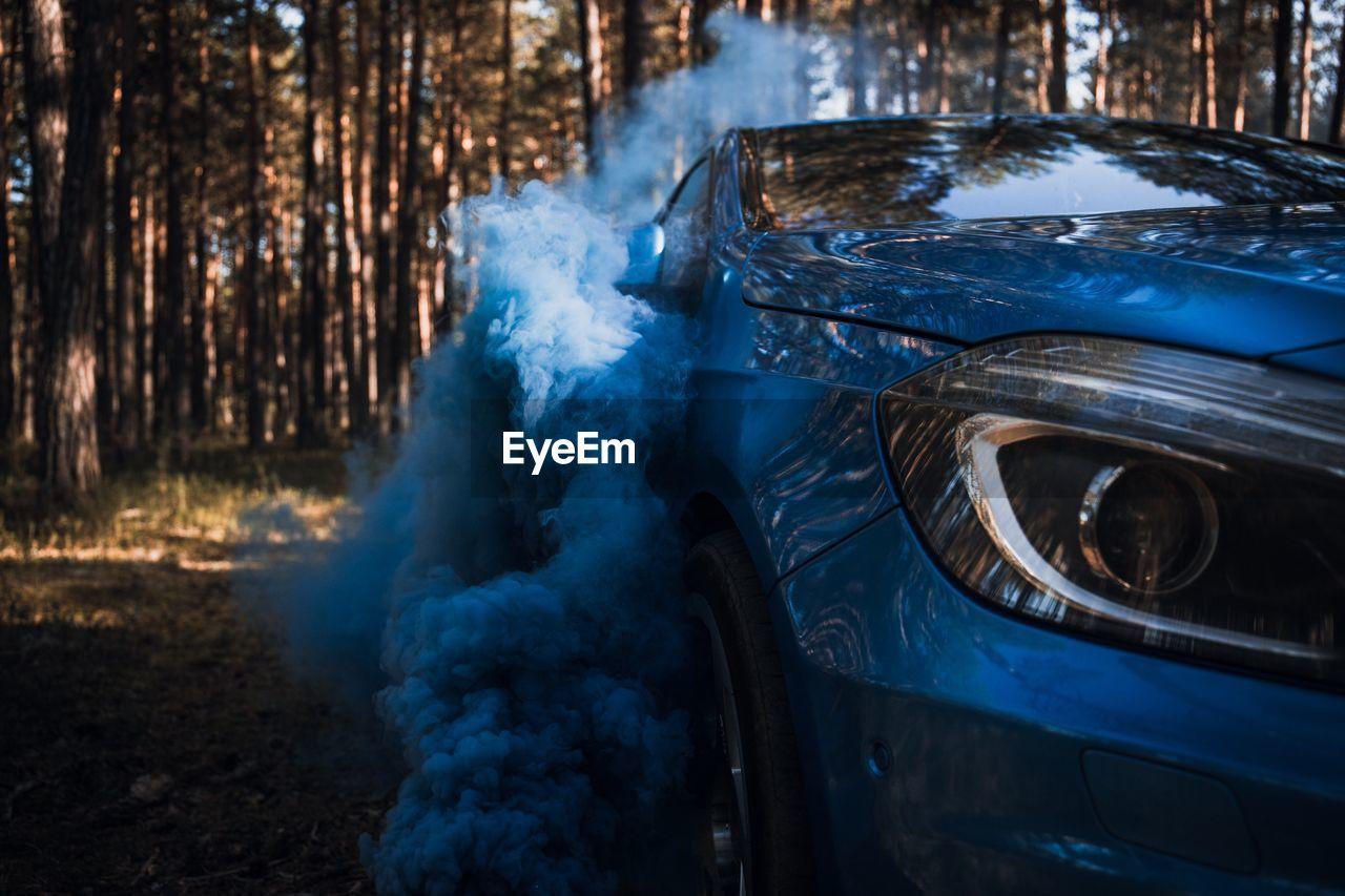 Close-Up Of Blue Car On Land