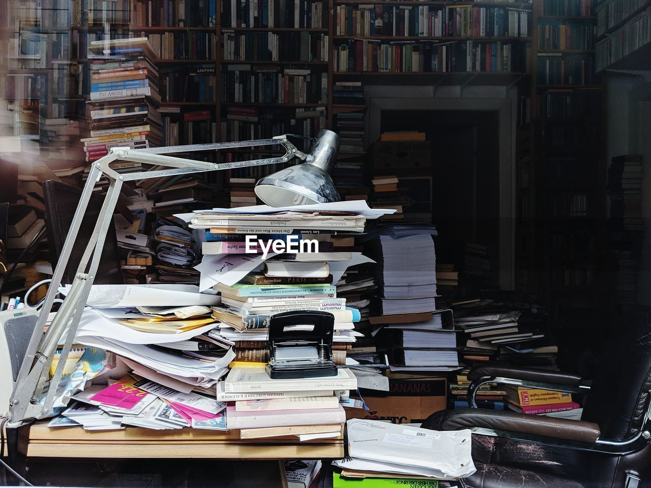 Stack of books on table in library