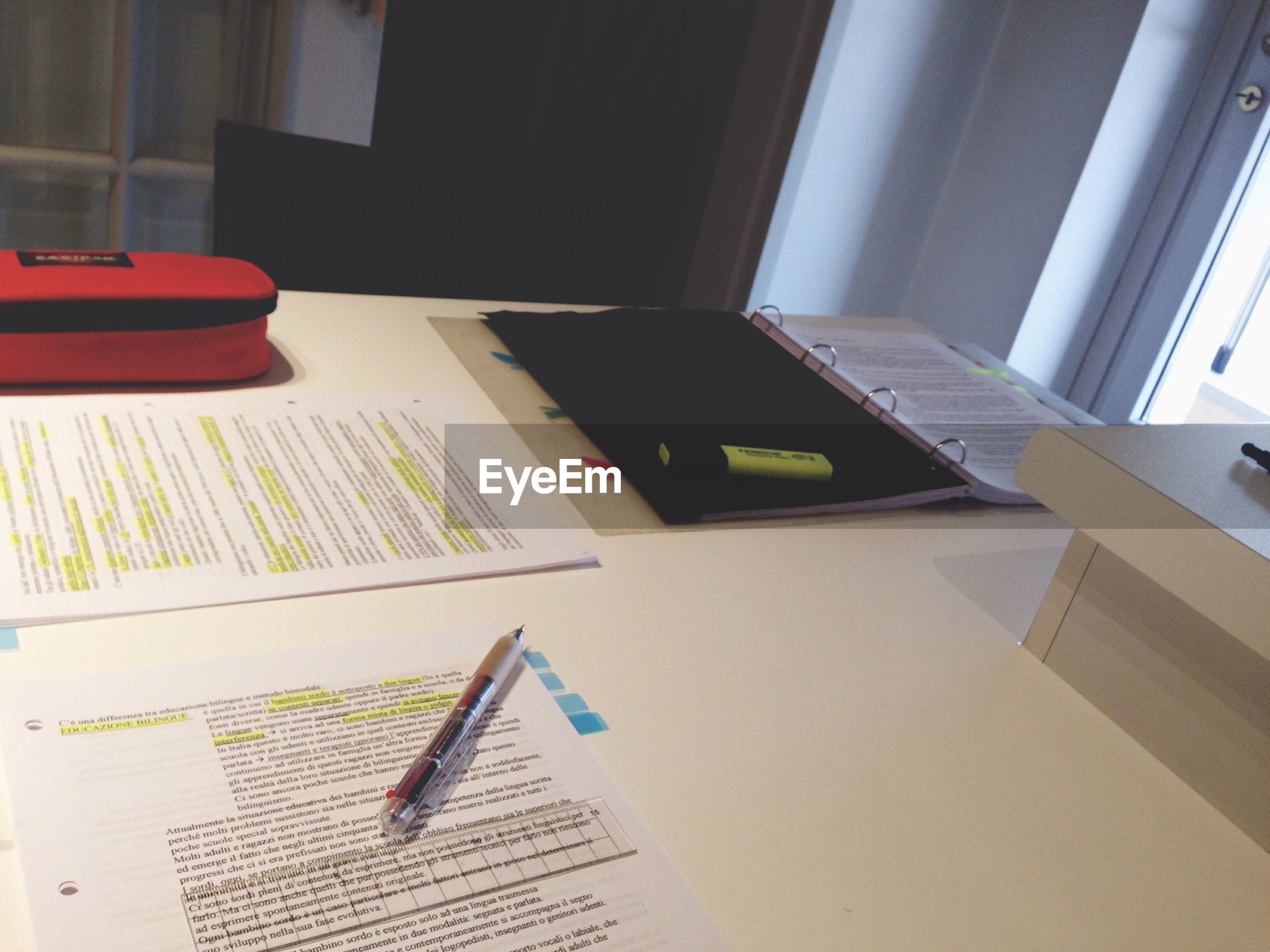 indoors, book, table, education, paper, desk, communication, office, laptop, pen, high angle view, home interior, document, chair, absence, still life, text, wireless technology, no people, learning
