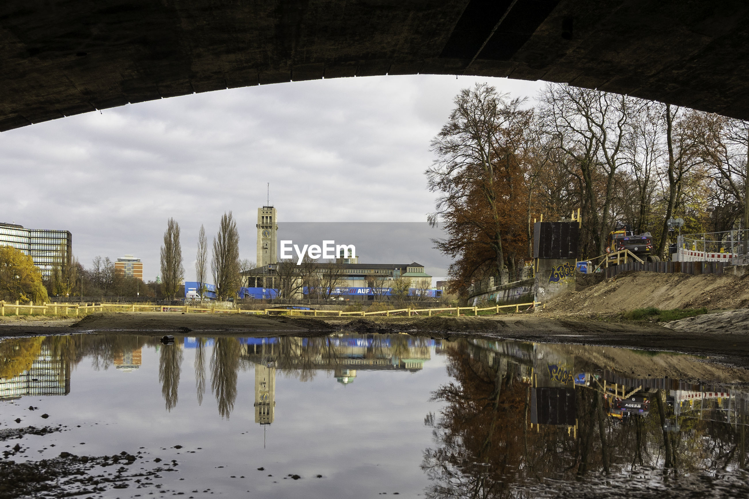REFLECTION OF BRIDGE AND BUILDINGS ON RIVER