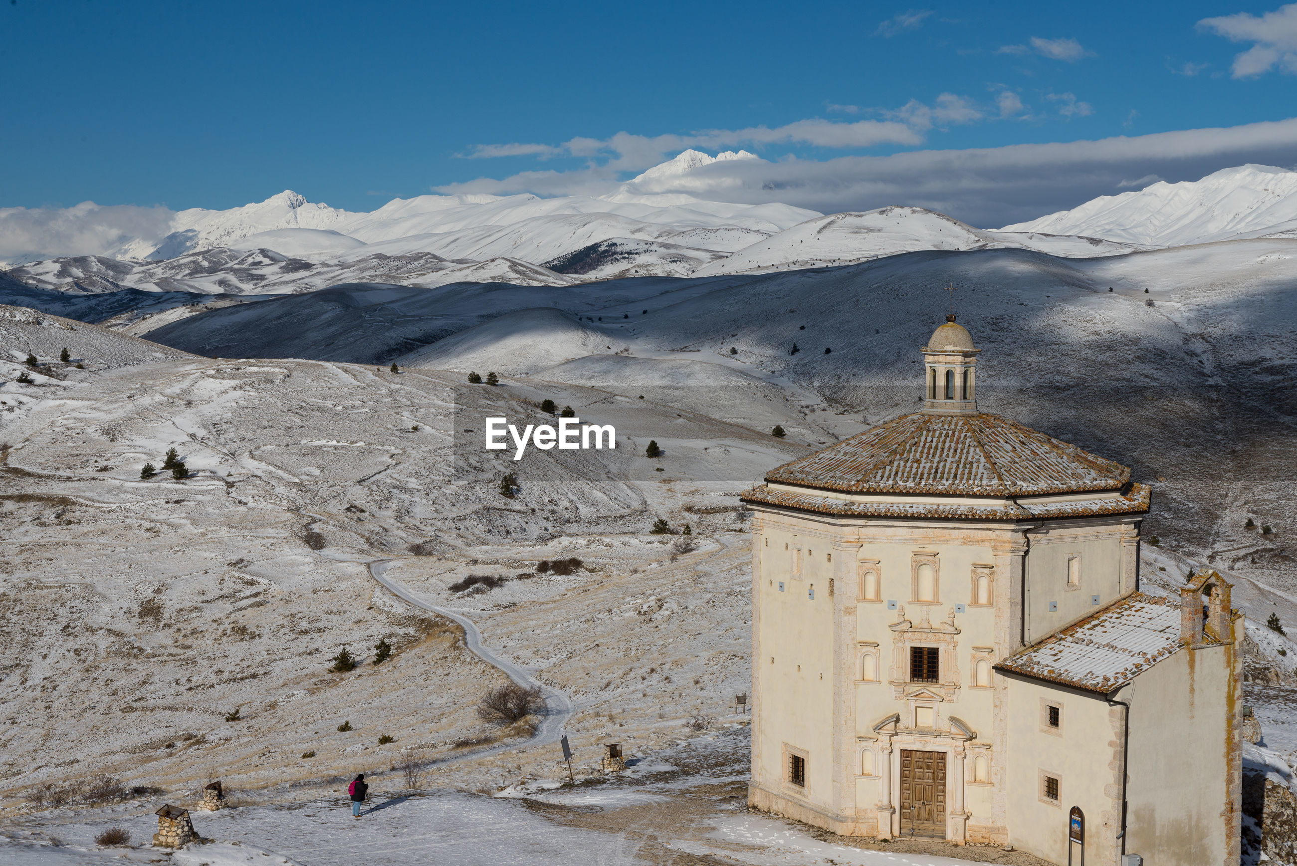 Ancient fortification and small church in the snowy mountains of abruzzo, italy