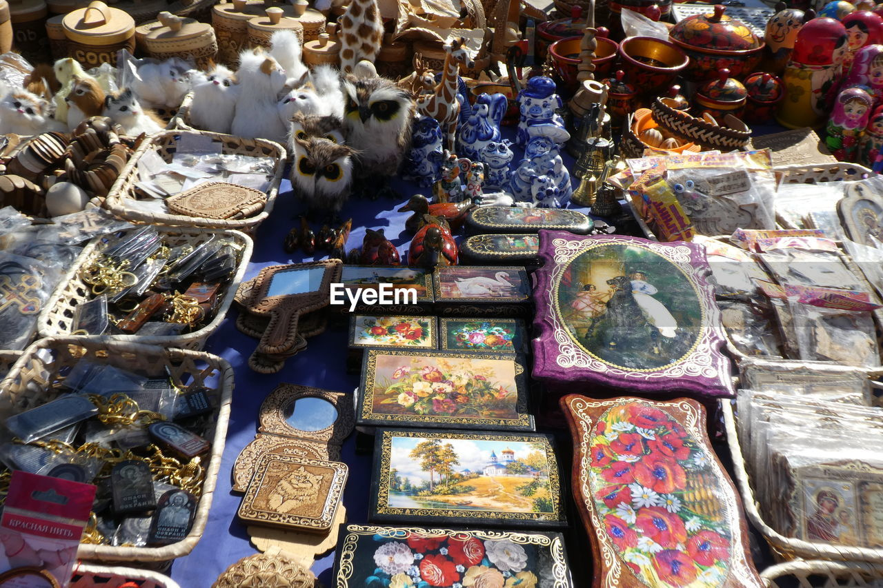 large group of objects, choice, variation, abundance, for sale, market, still life, art and craft, high angle view, no people, collection, indoors, multi colored, arrangement, representation, retail, day, sale, stack, container, retail display, silver colored