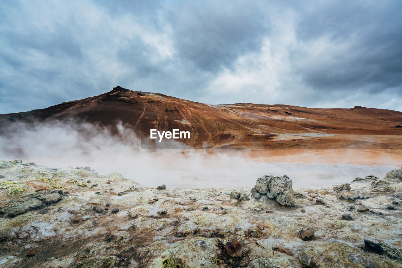 Scenic View Of Geyser At Volcanic Crater Against Sky